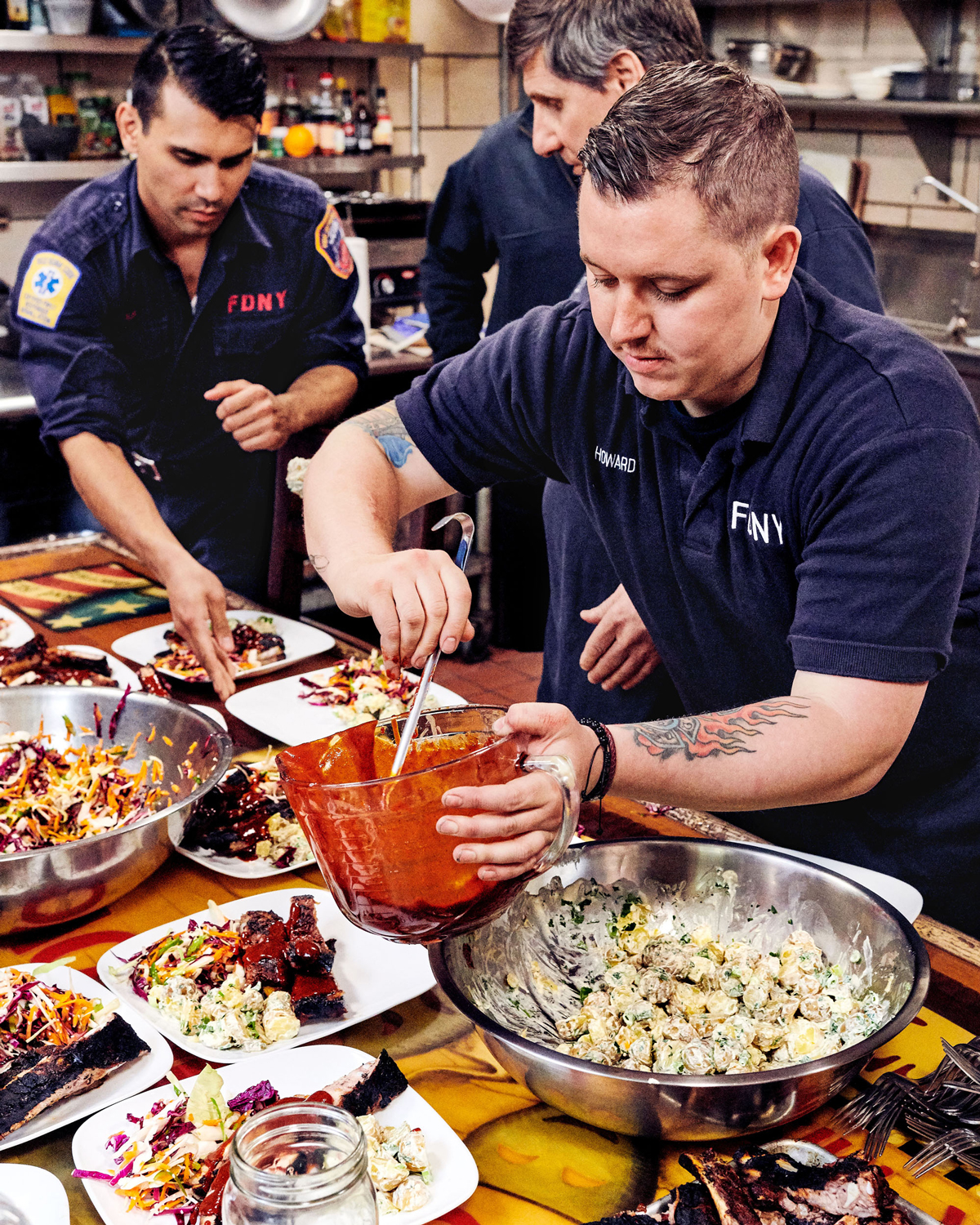firefighters plating coleslaw and potato salad