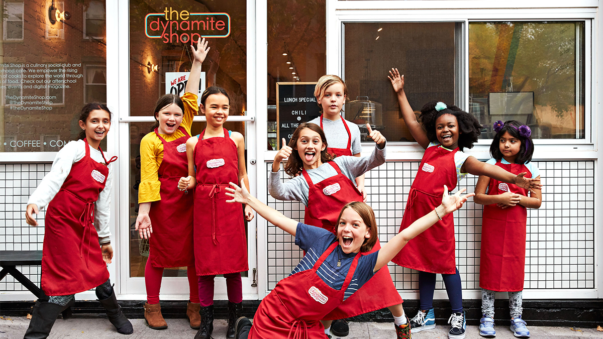 kids-in-aprons-in-front-of-shop-97564bb7