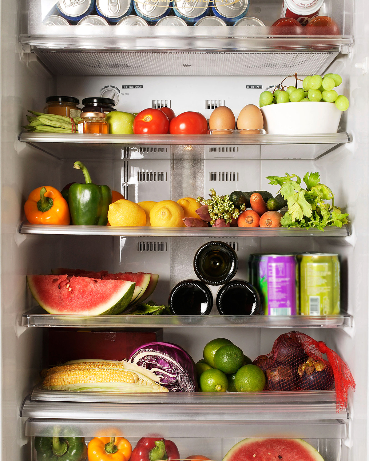 fridge filled with fresh produce and drinks
