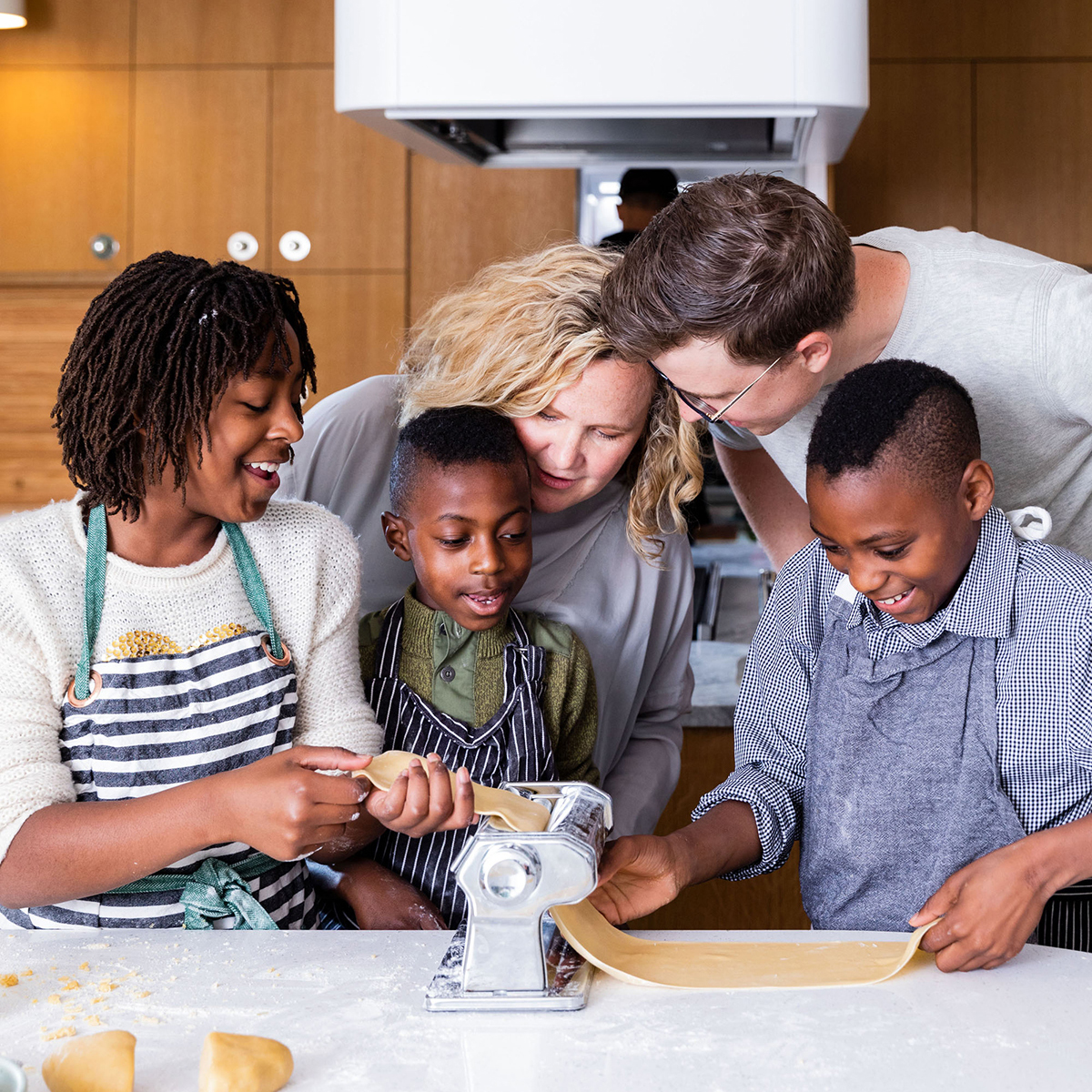 Kim and Tyler with kids making pasta