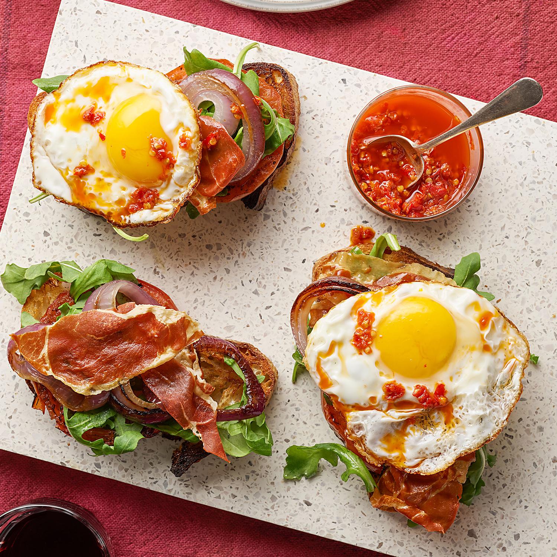 Breakfast Bruschetta: Charred Bread with Grilled Tomatoes, Crispy Prosciutto & Eggs
