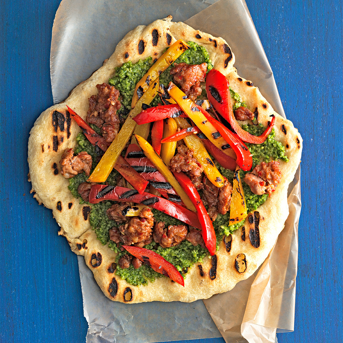 hot-sausage-sweet-pepper-pizzas-with-almond-pesto-101904531