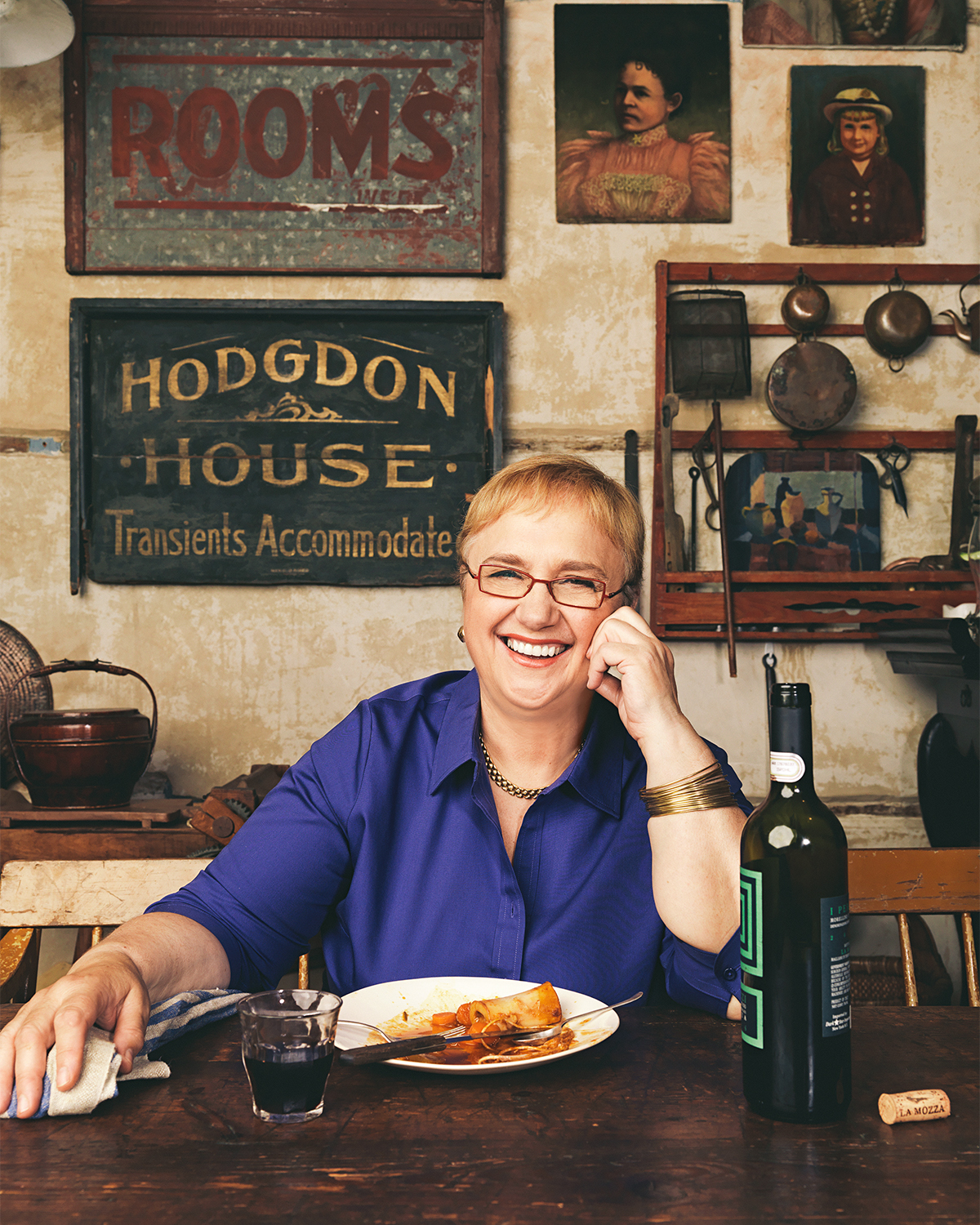 Lidia Bastianich smiling at table with pasta