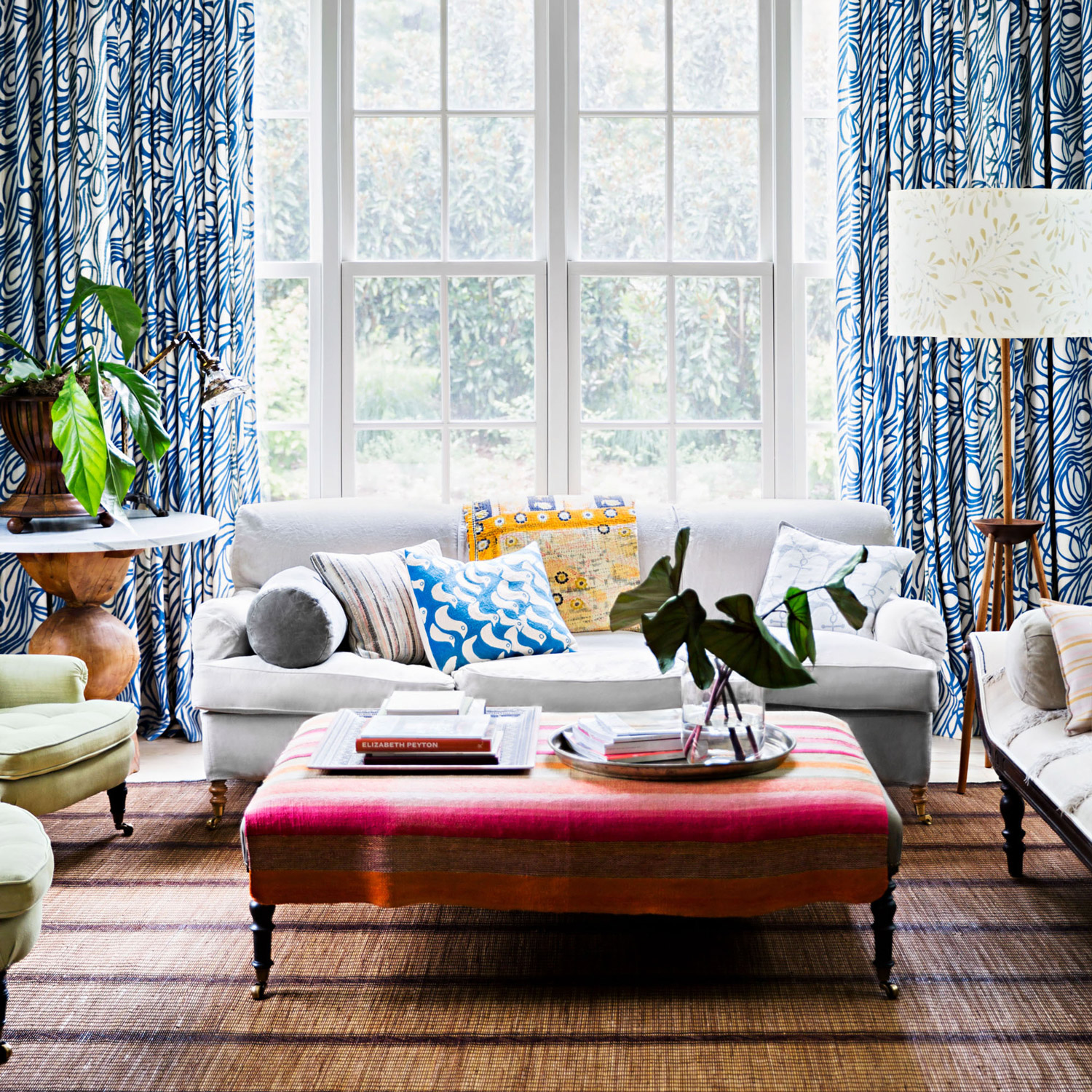 living room with striped ottoman doubling as table