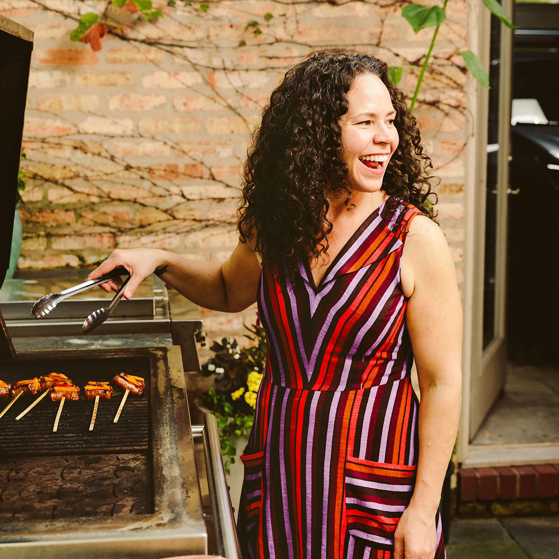 Stephanie grilling sausage skewers