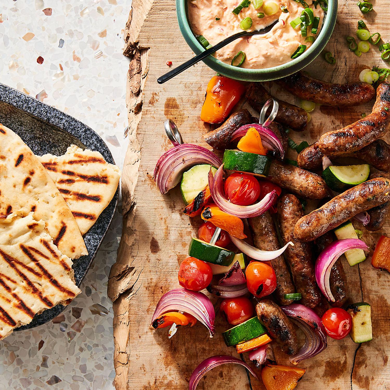 Grilled Merguez Sausages with Veggie Skewers & Yogurt-Harissa Sauce