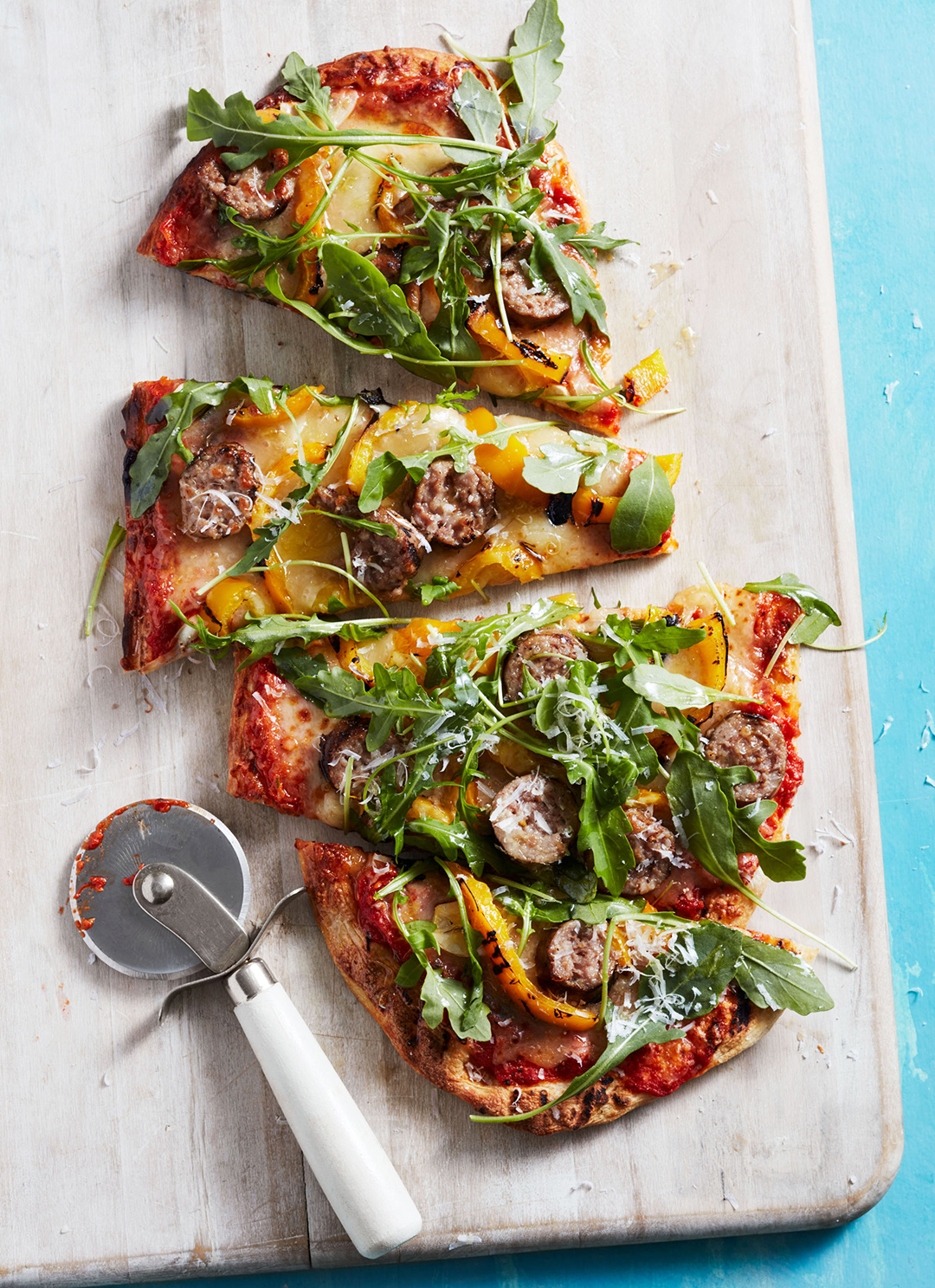 grilled pizza with sausage and peppers