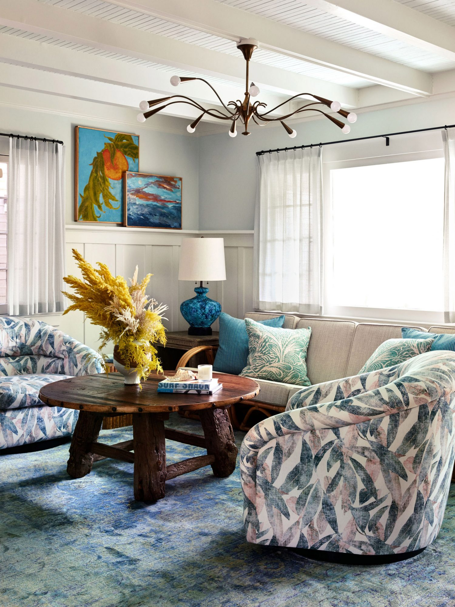 beachy living room with pastel palm furniture