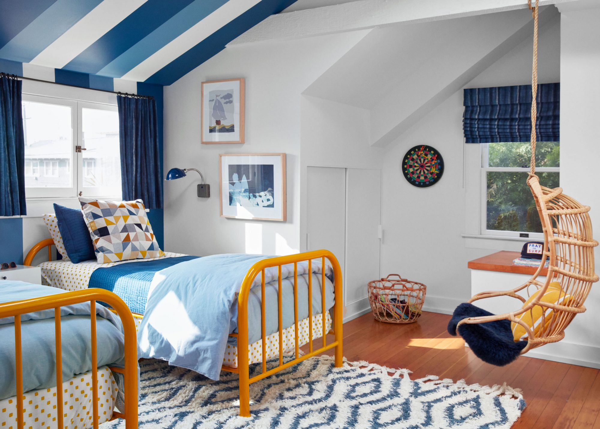 boys blue and white bedroom with hanging rattan chair