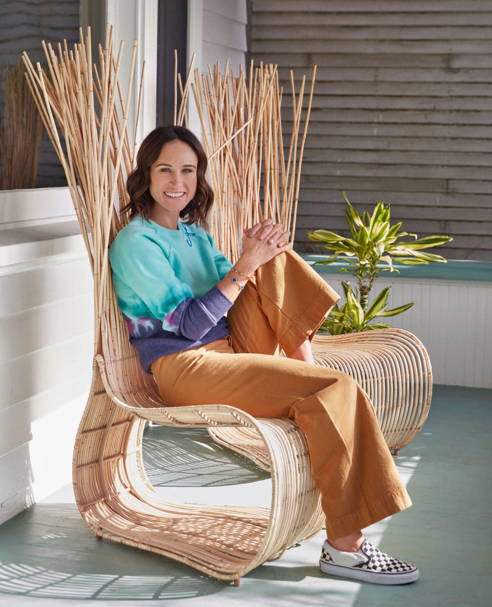 melissa akkaway sitting on rattan chair on front porch