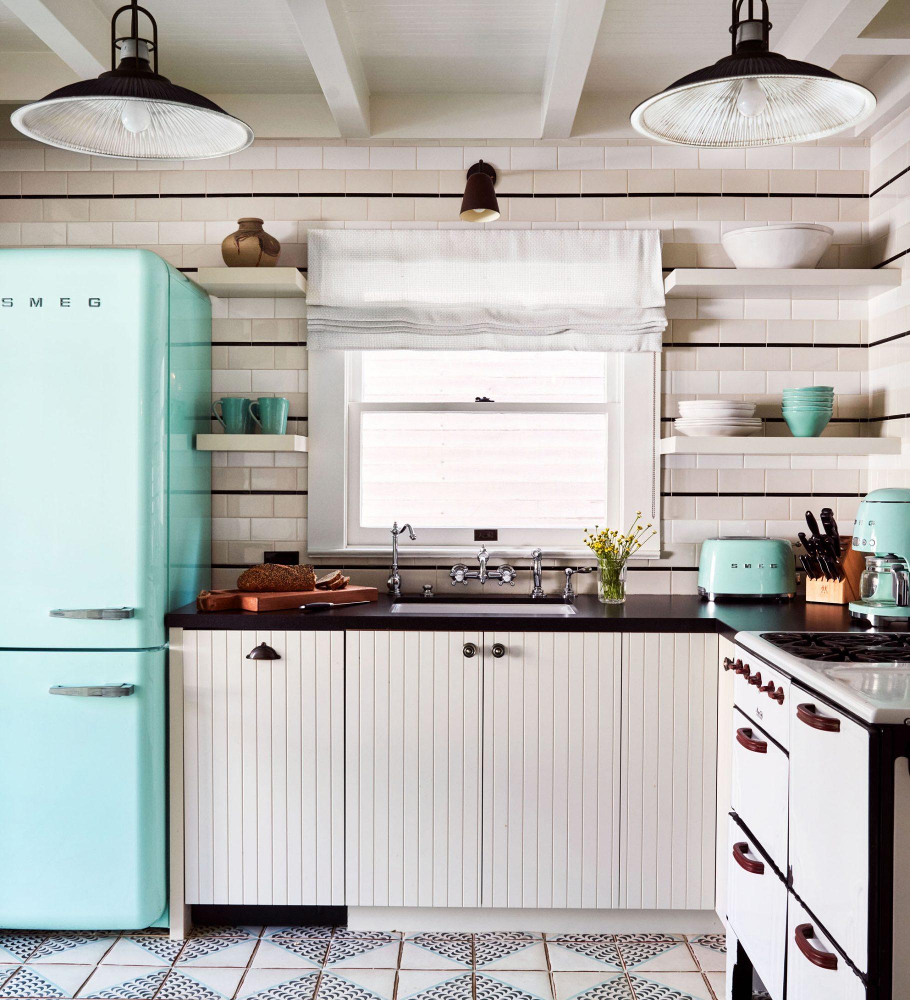 white kitchen with turquoise vintage appliances