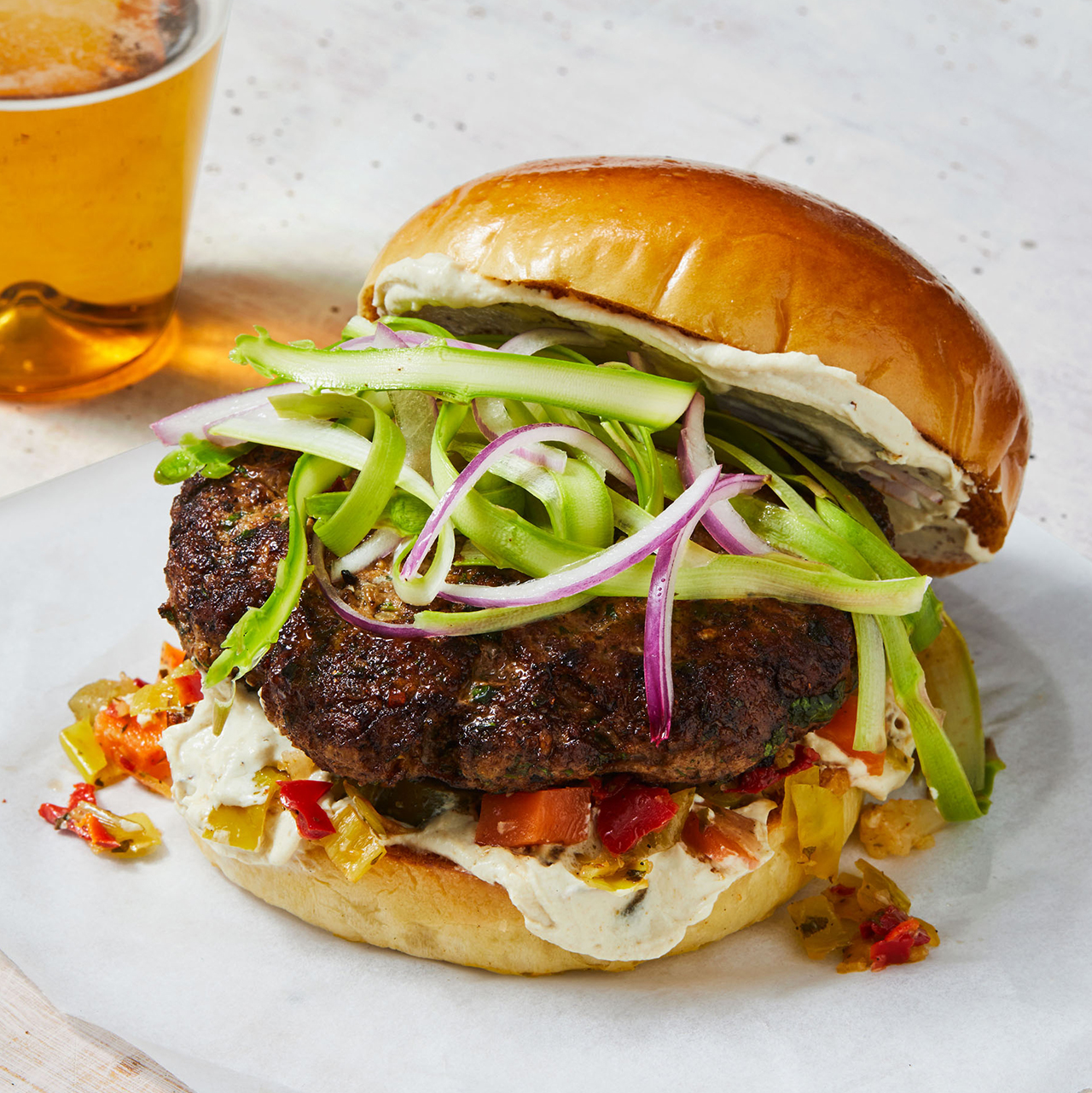 herby lamb burgers with shaved asparagus and tahini sauce