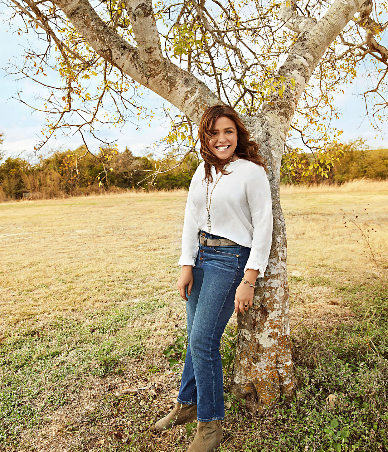Rachael Ray leaning against tree