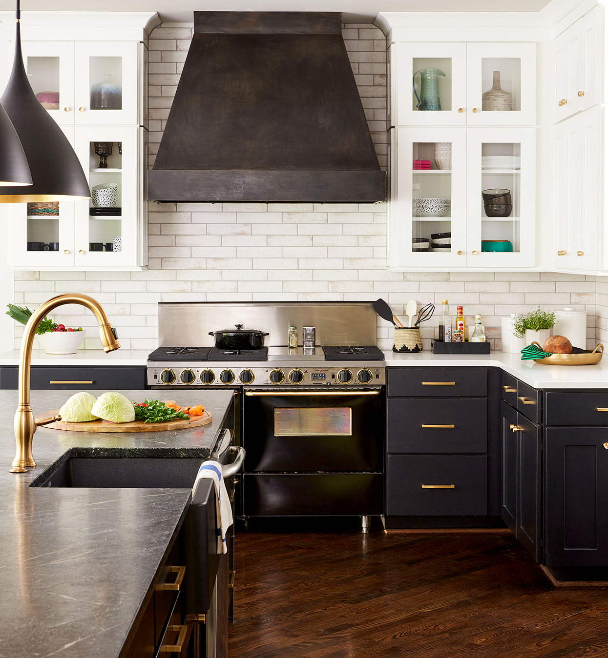 kitchen with white upper and black lower cabinets