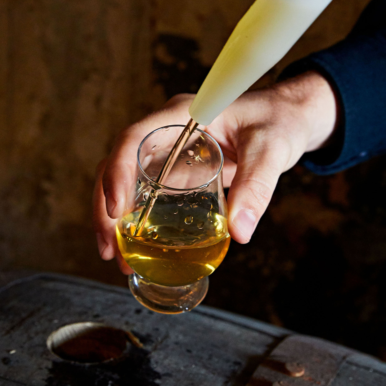 barrel sample of cider from thief tool