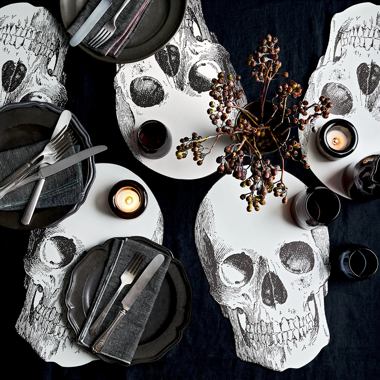 monochromatic tablescape with skull paper placemats