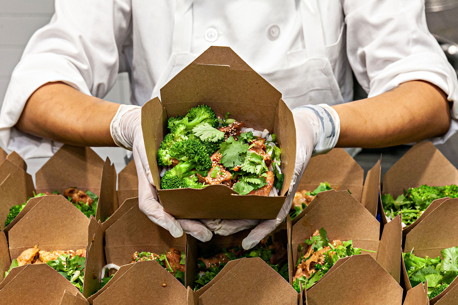 chef showing boxed fresh food