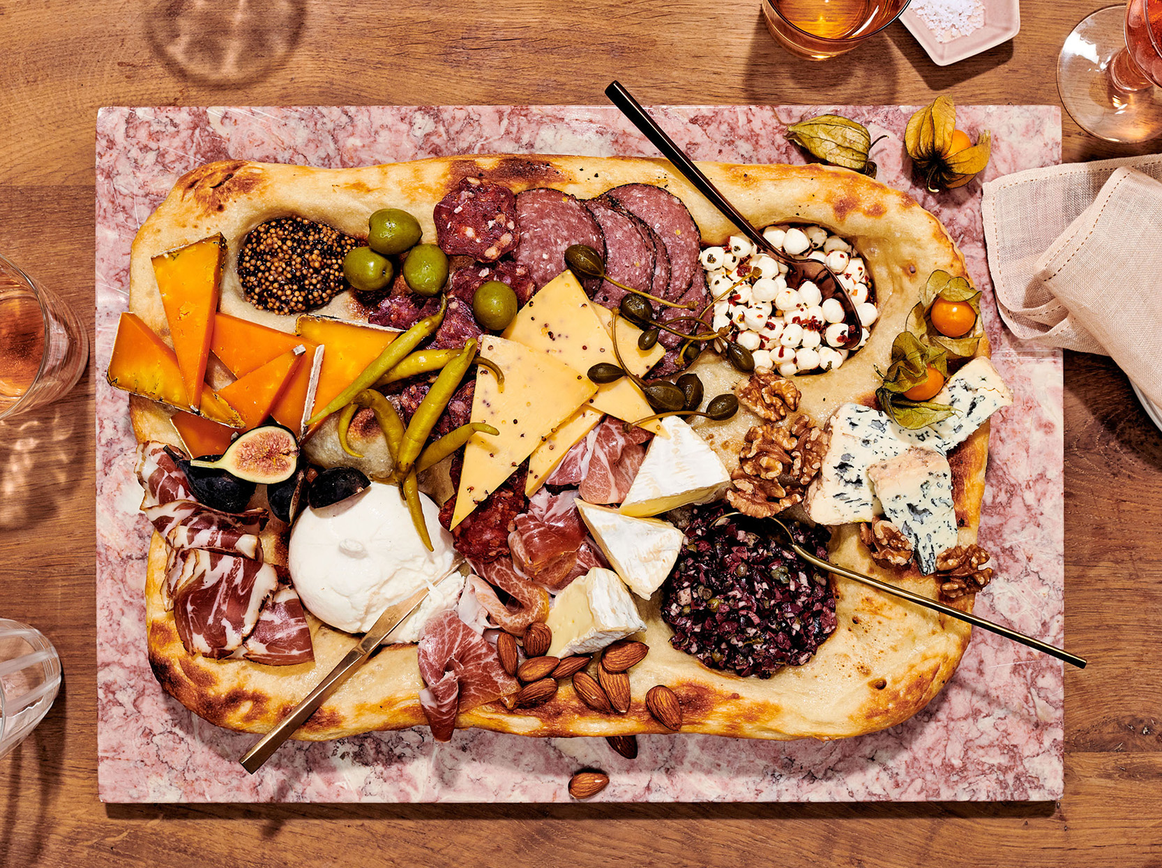 overhead view of incredible edible cheese board on table