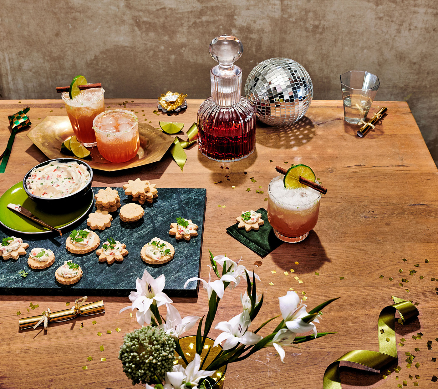 New Year's table with cocktails, appetizers, and decor