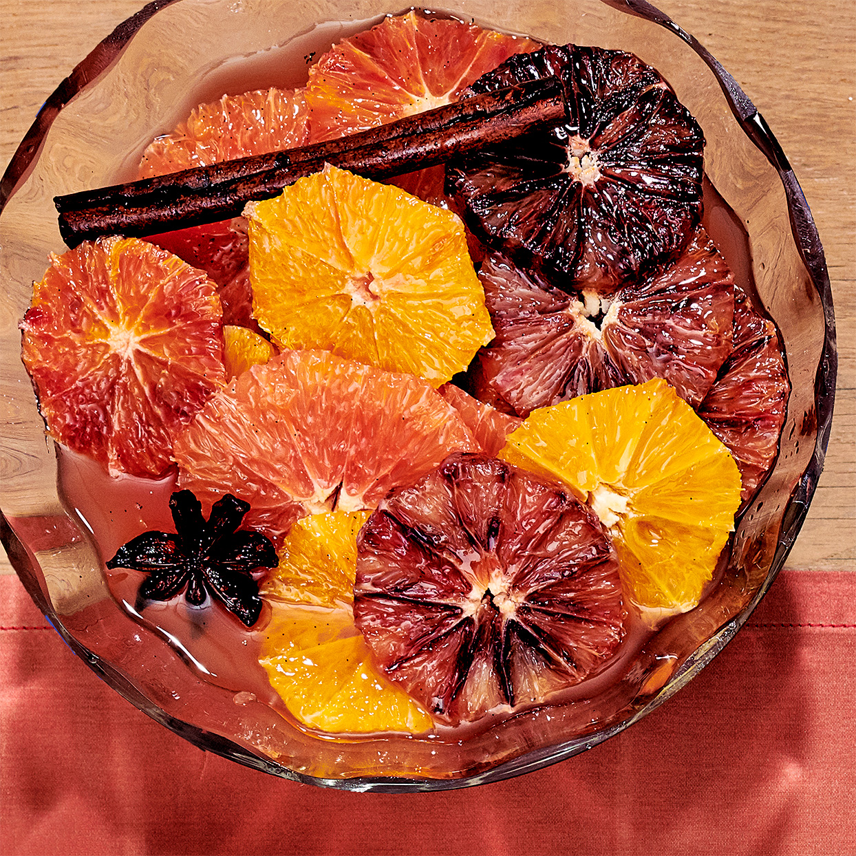 spiced citrus compote in glass bowl with cinnamon stick
