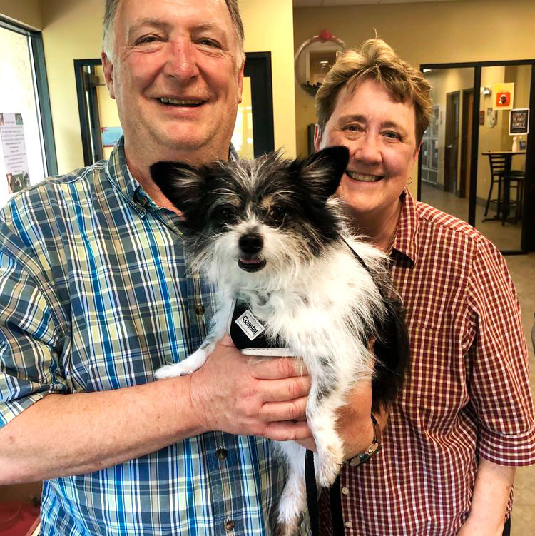 dog named Gibbs held by owners gregory and joan