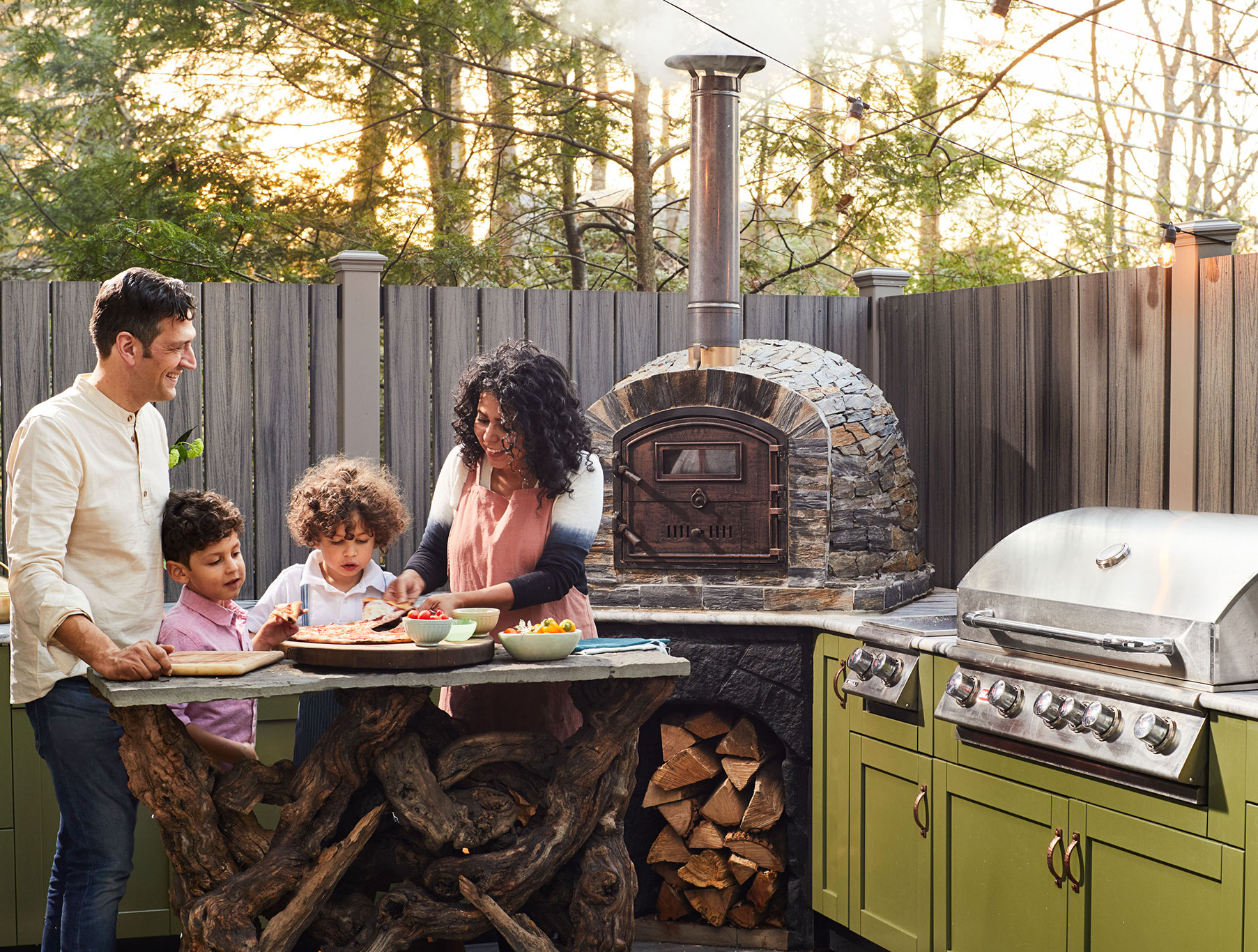 Evette Rios home outdoor kitchen family making pizza