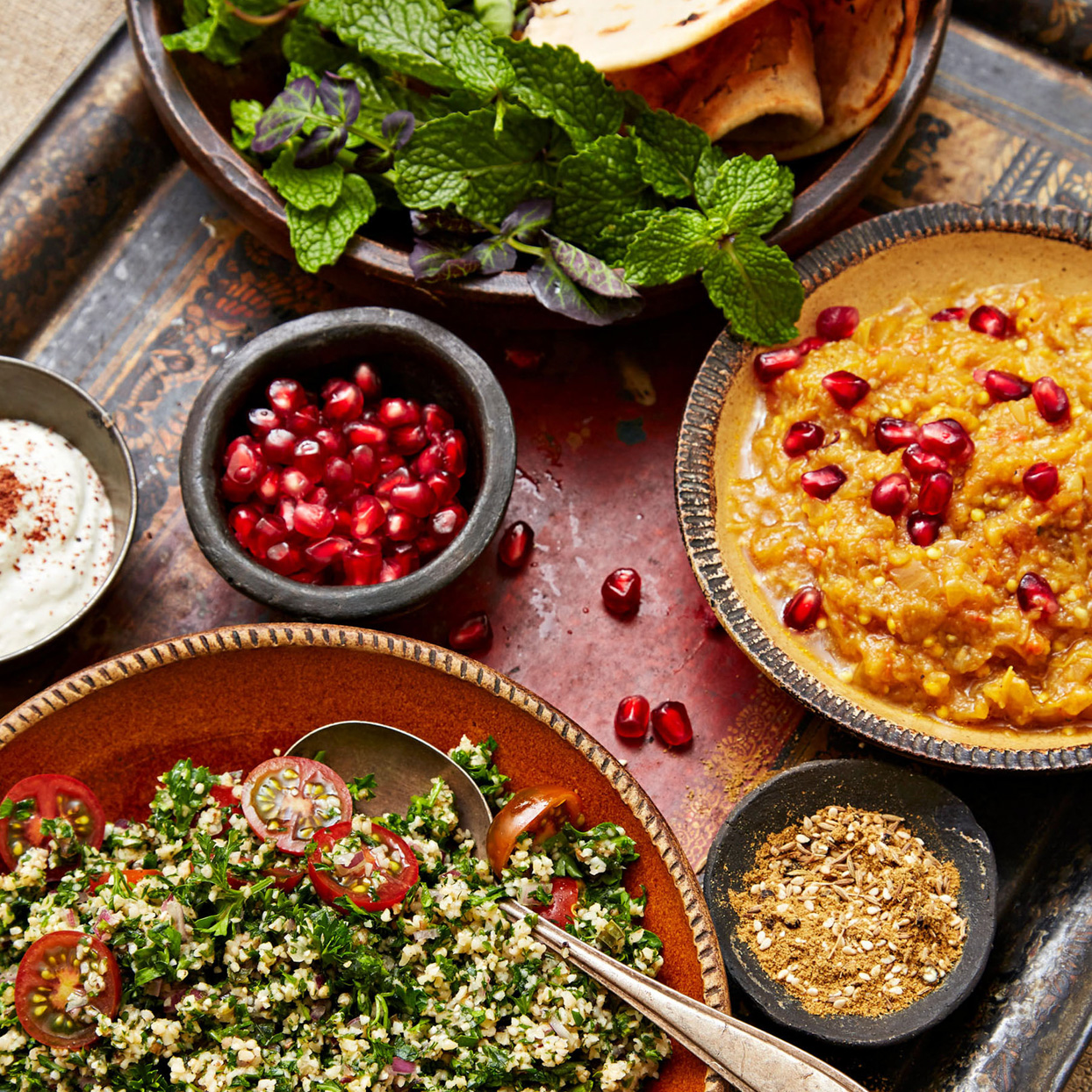 tabbouleh salad and other foods on table