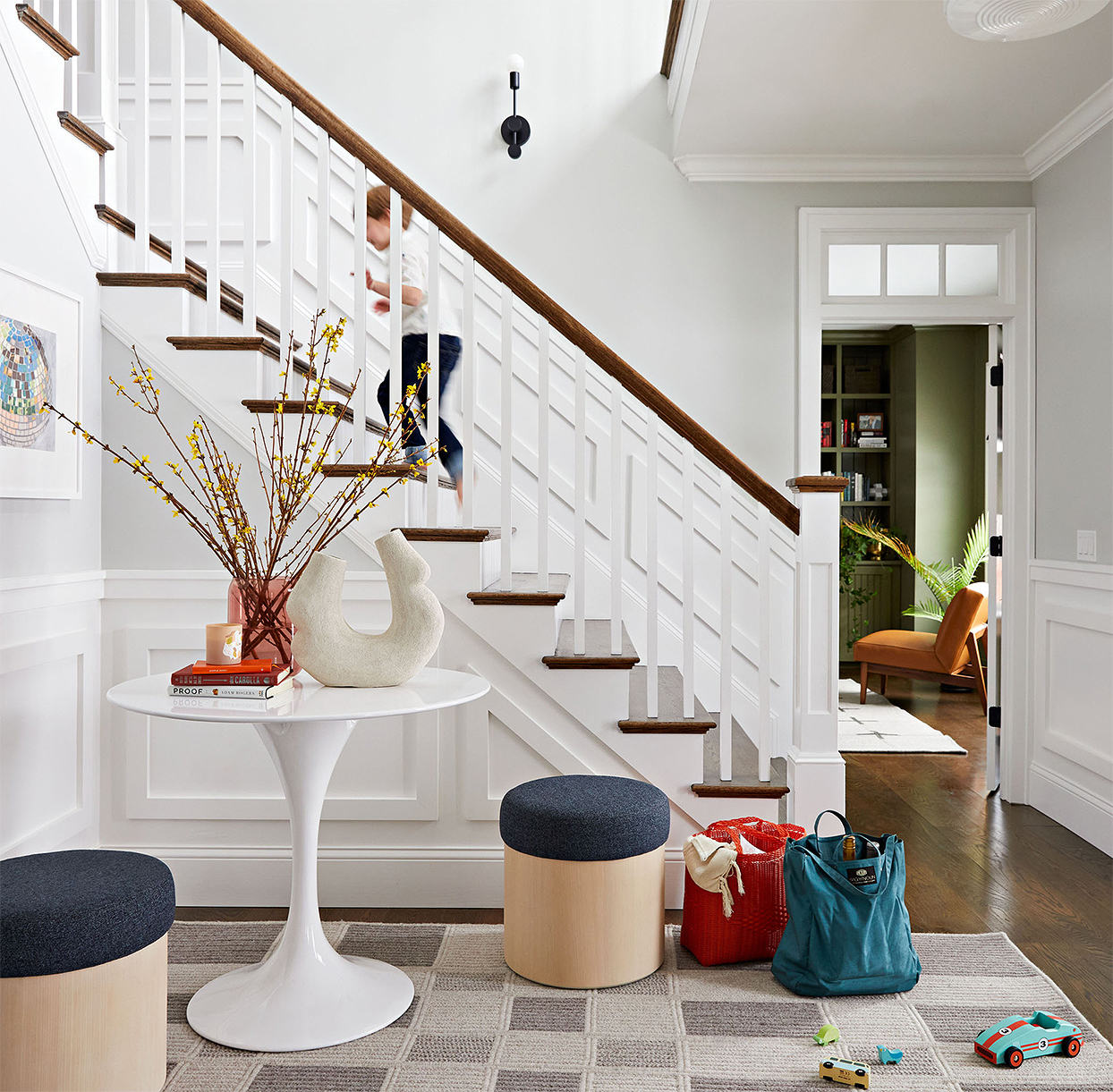 modern entryway stairs child table stools bags