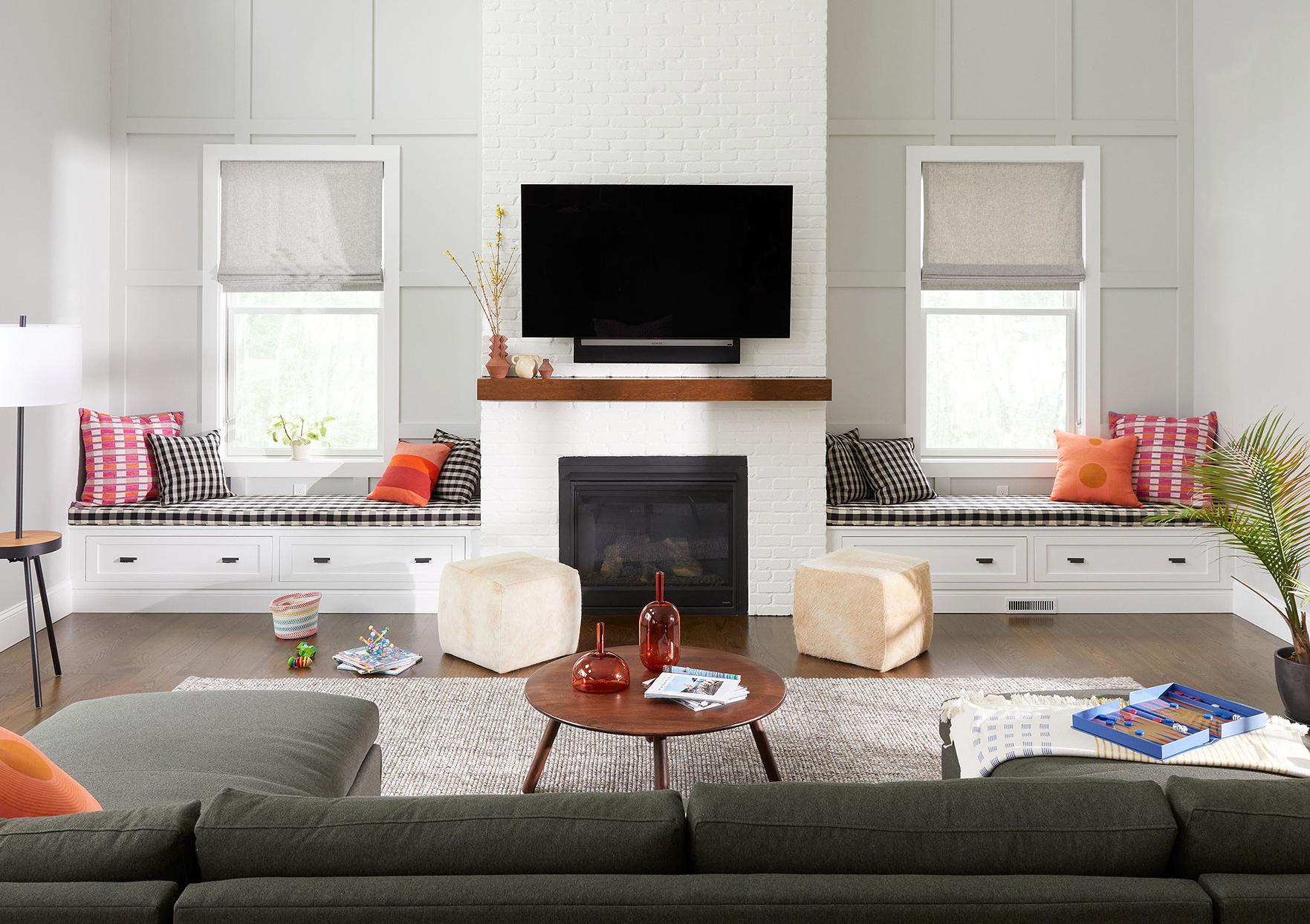 asymmetrical living room white walls window seats
