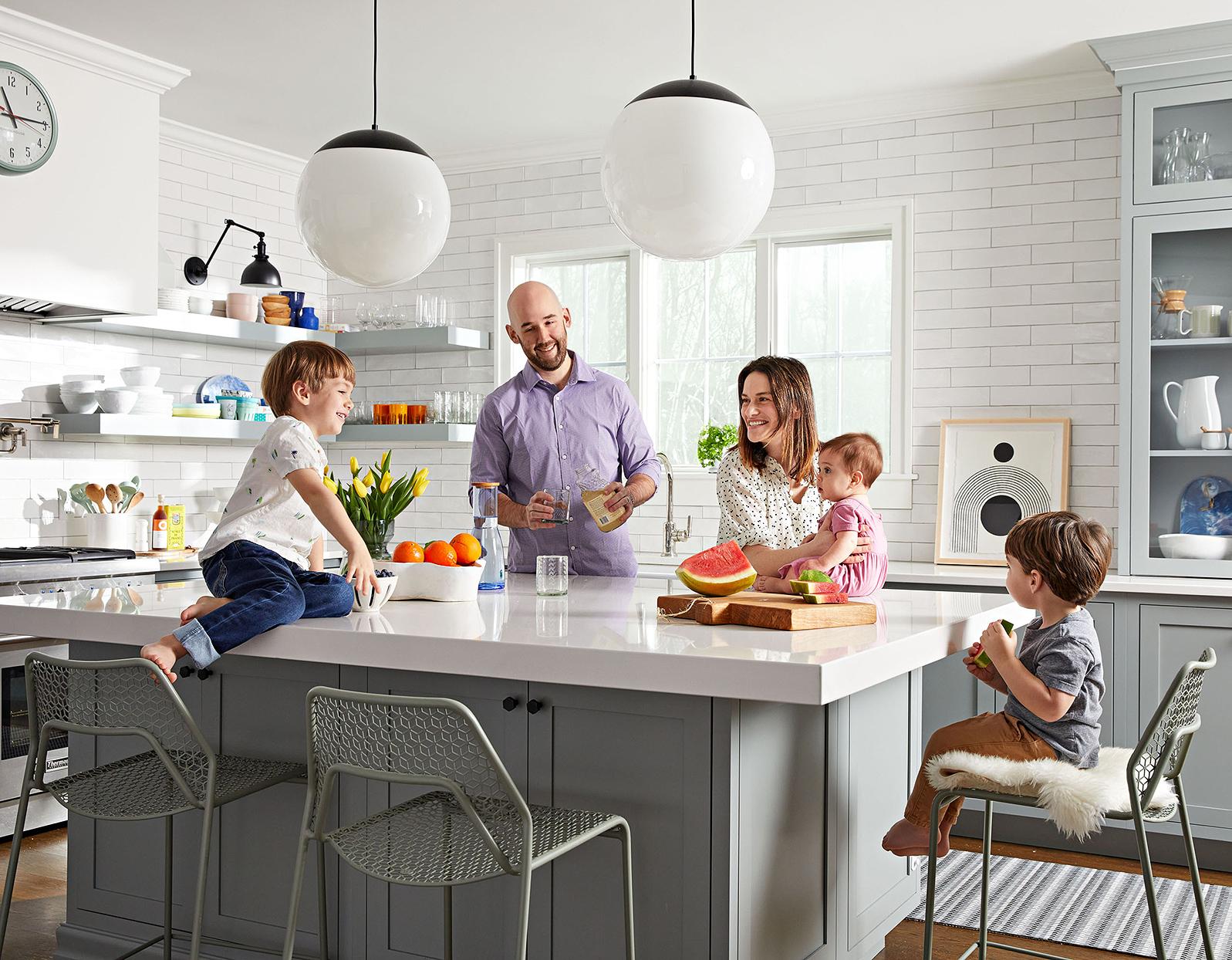 family smiling kids kitchen island fruit