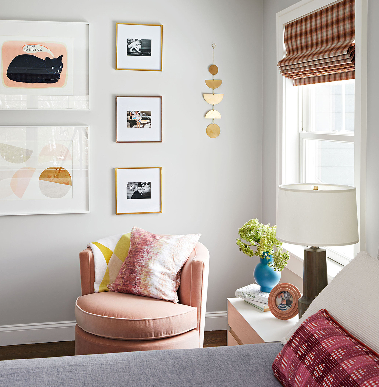 eclectic master bedroom pink chair framed prints