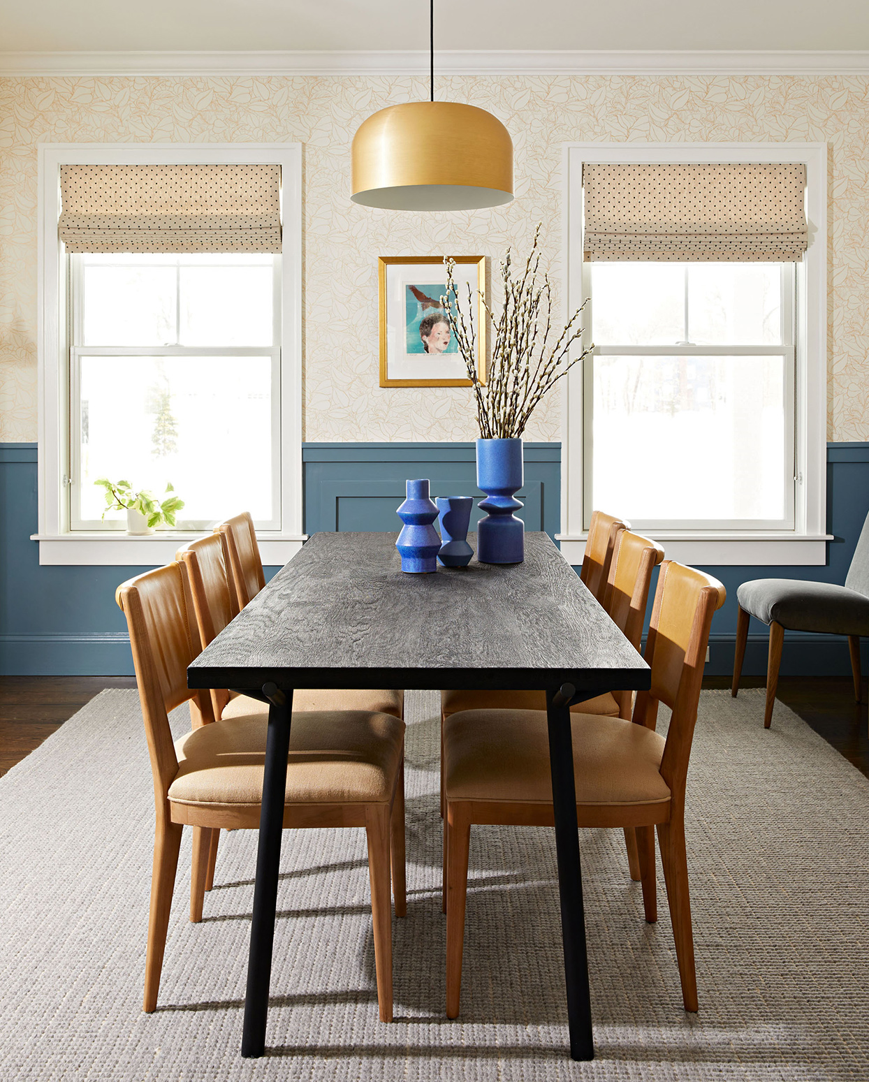 dining room table blue vases gold pendant light