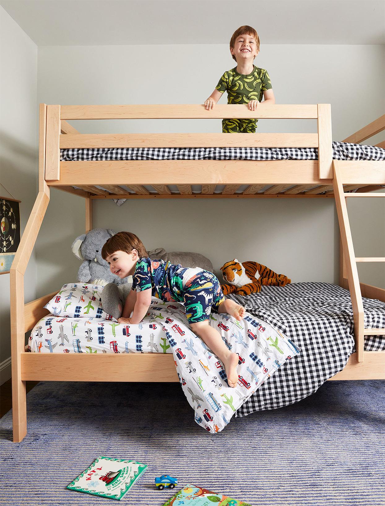 young boys in pajamas in bunk bead
