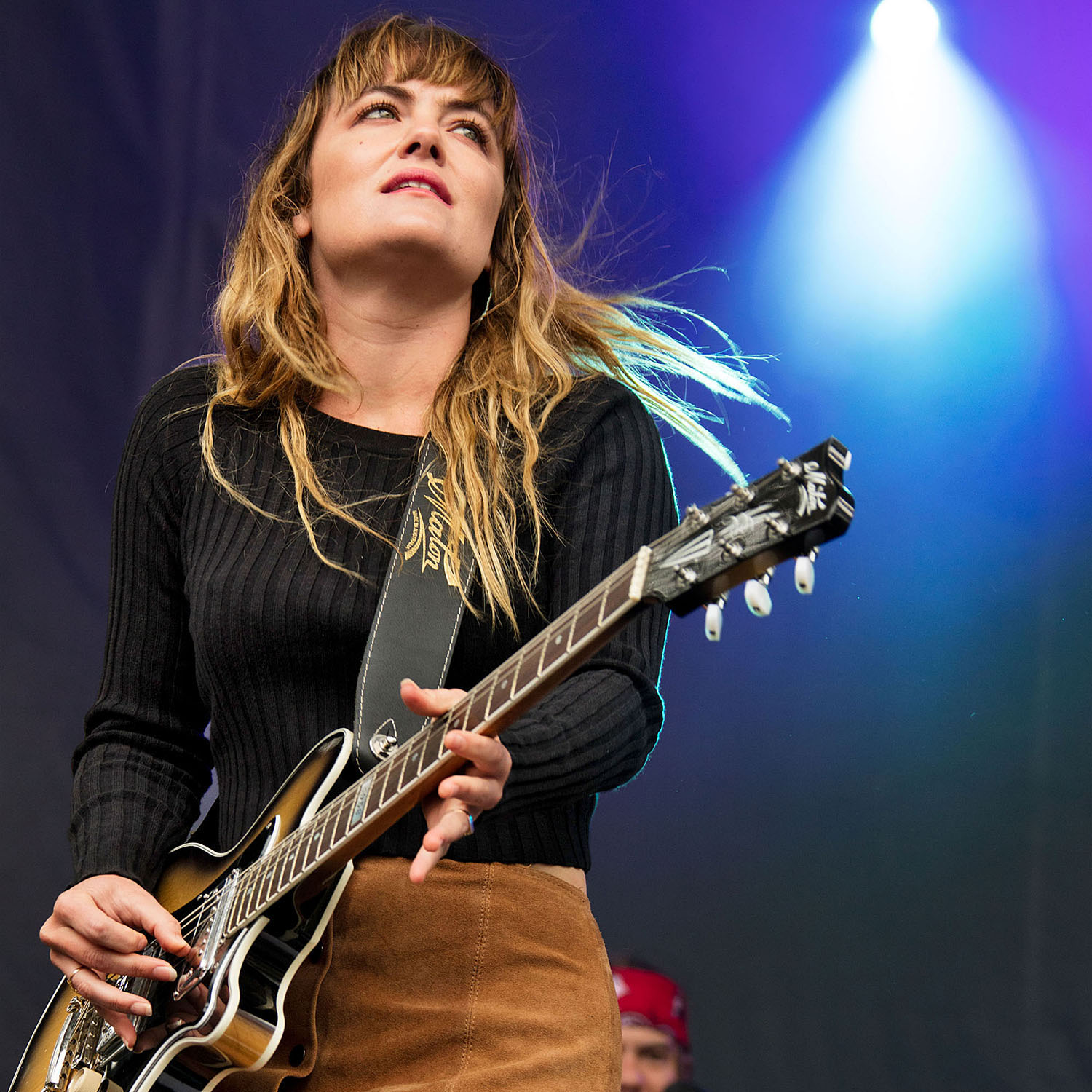 Julia Stone playing guitar on stage