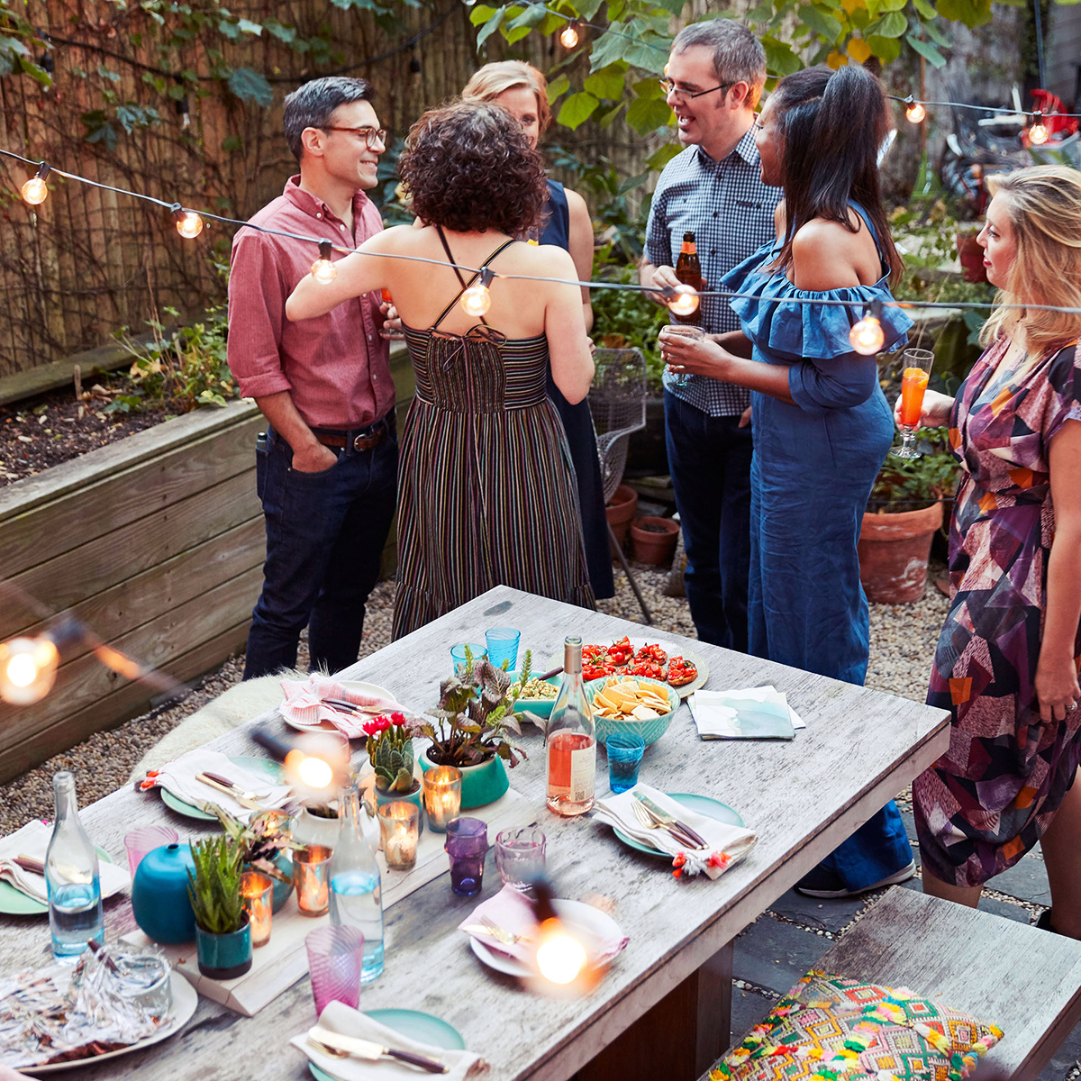 adults mingling guests dinner party