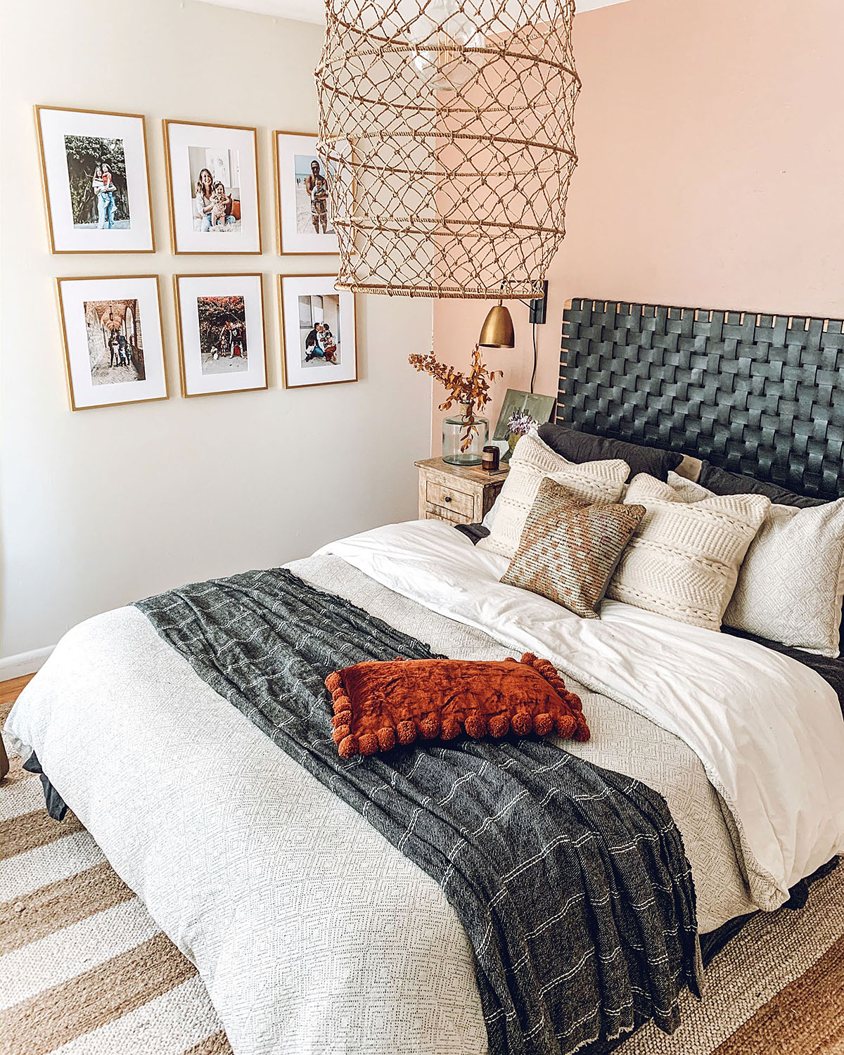 master bedroom with peach accent wall