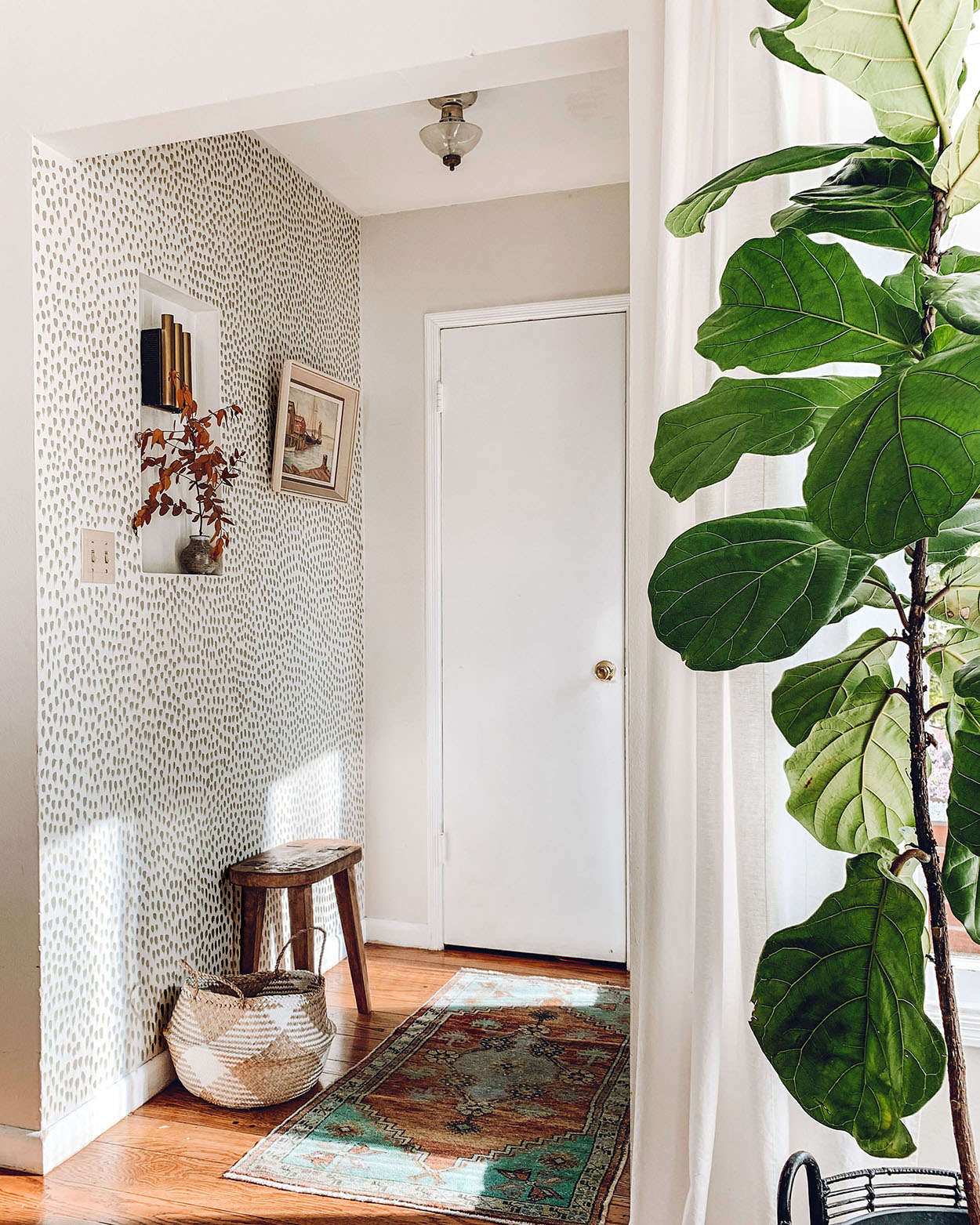 family entryway with hand-painted accent wall