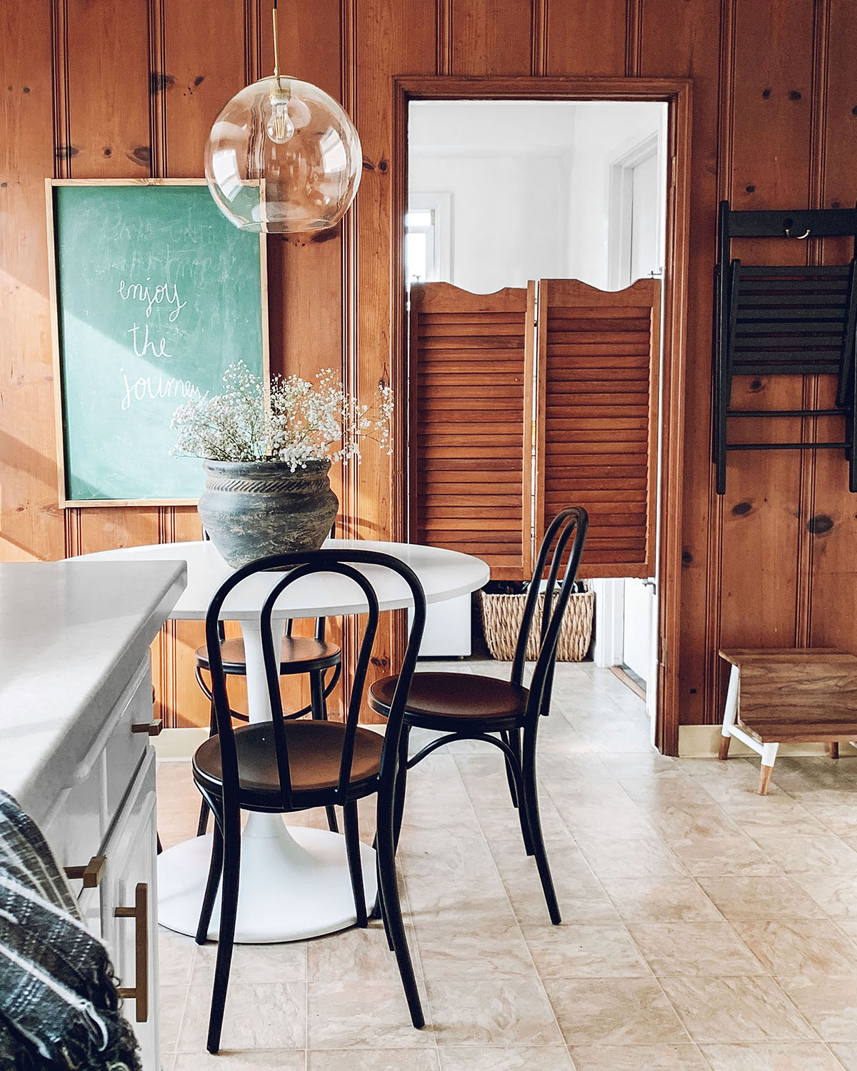 wood paneled kitchen with white table