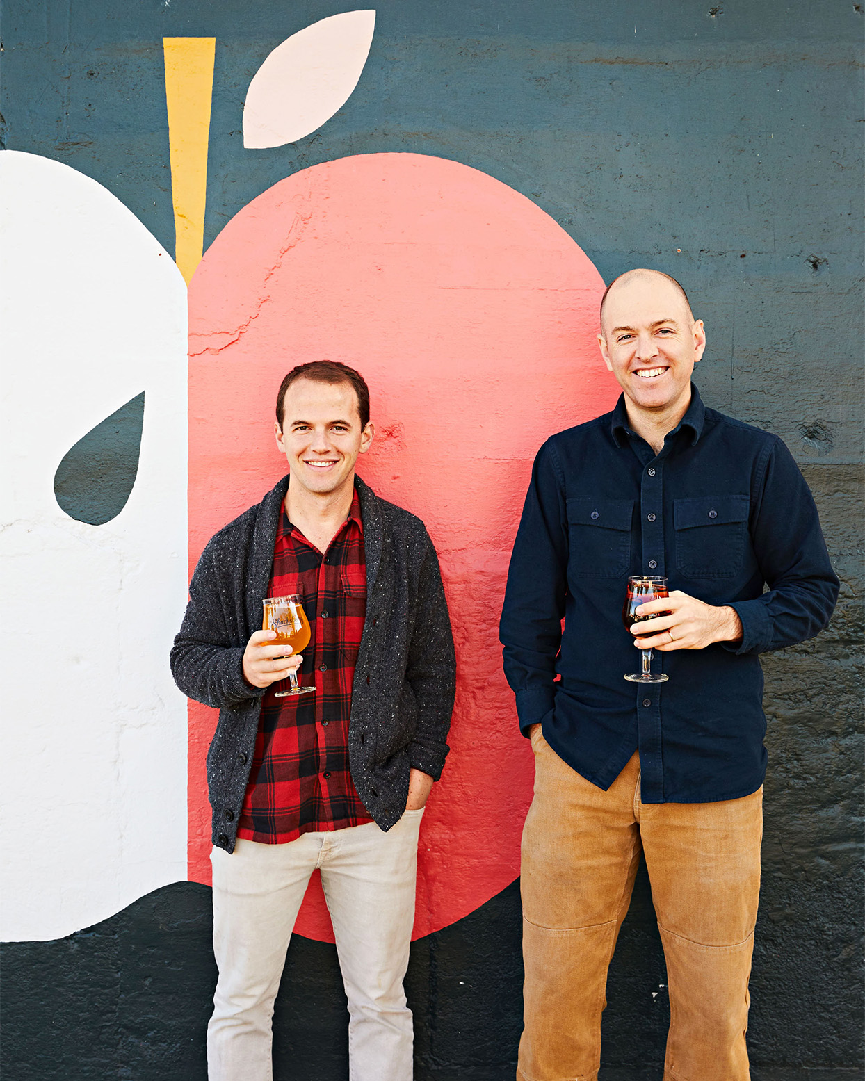 tasting room outdoor apple mural with owners