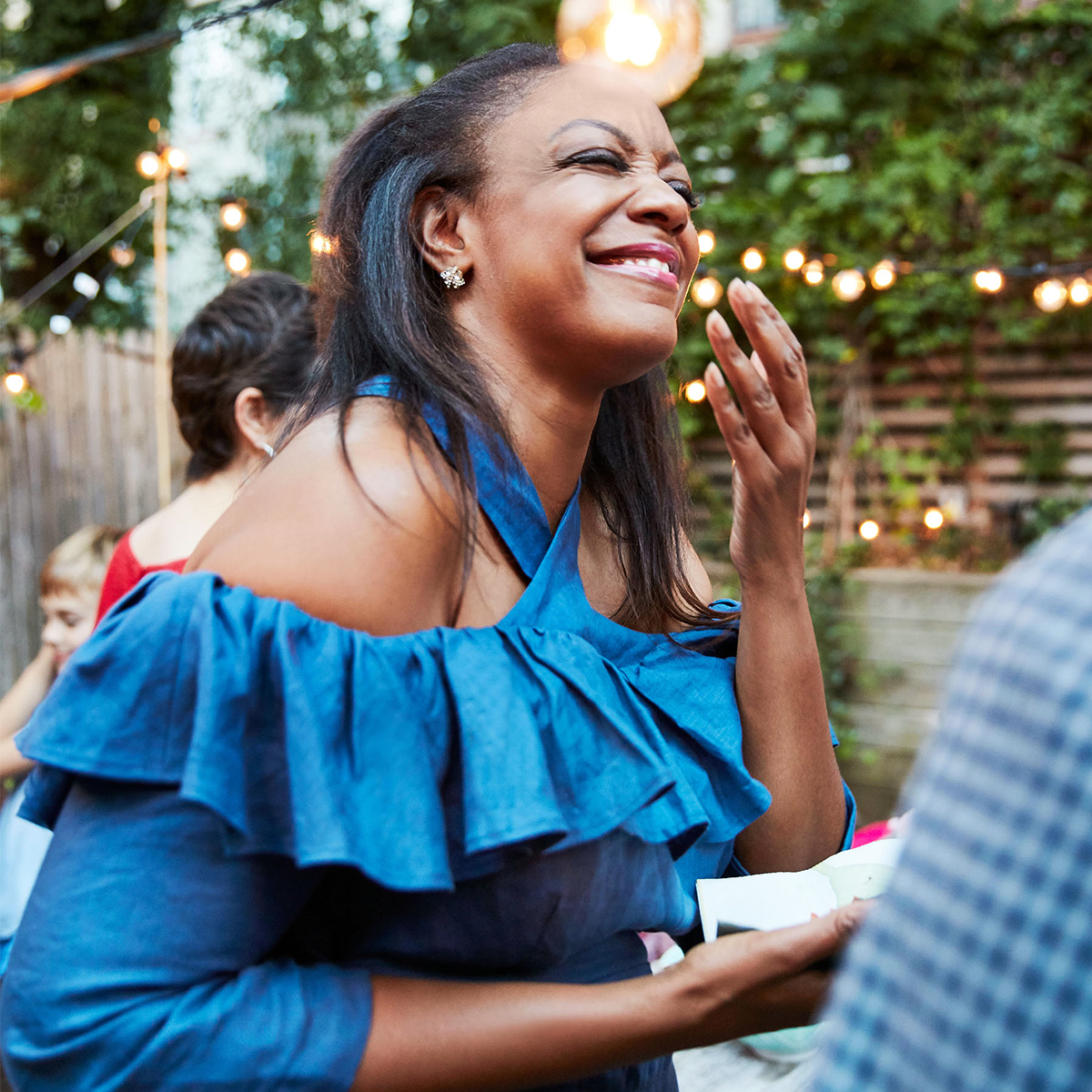 woman mingling guest summer party