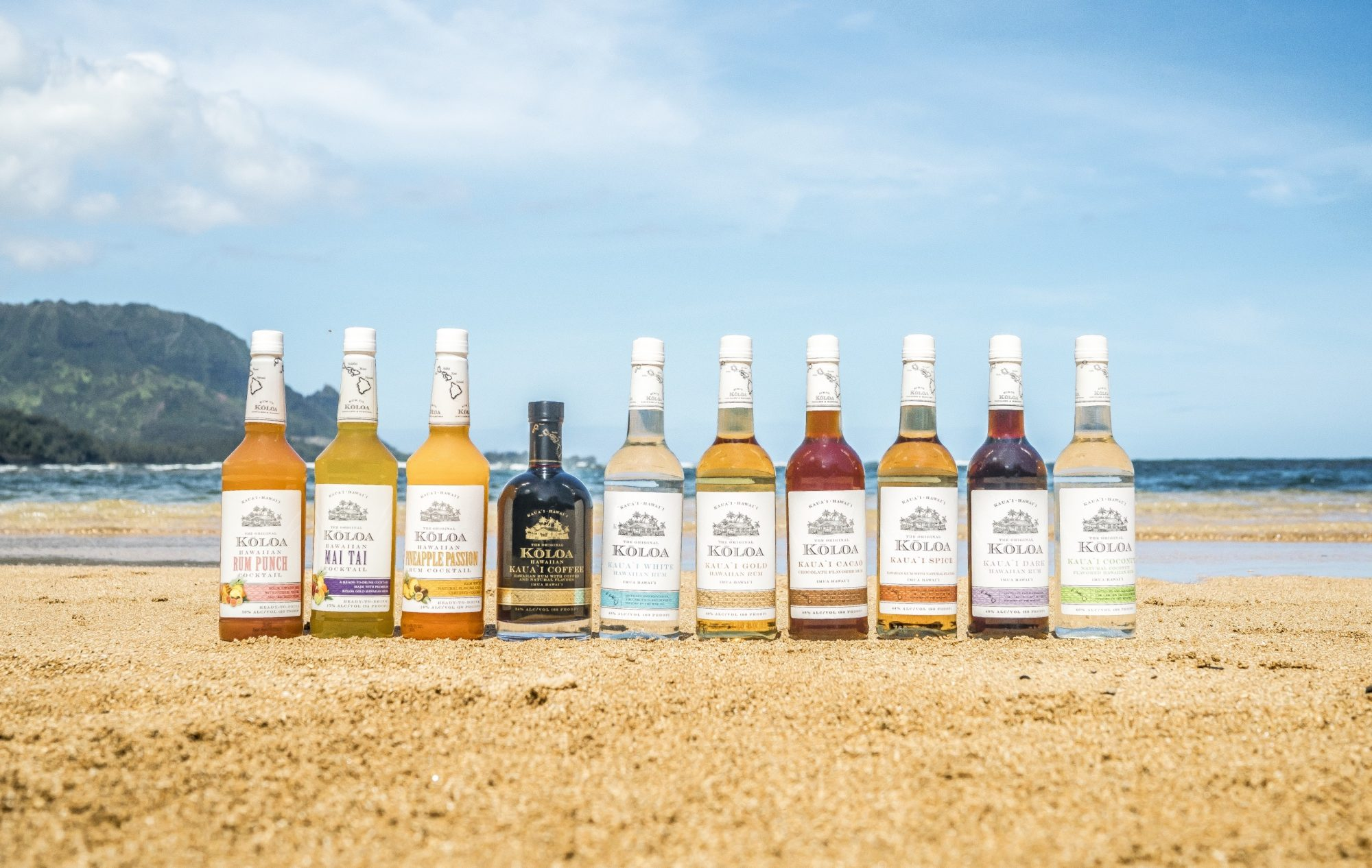 Koloa's rums and bottled cocktails lined up on the beach