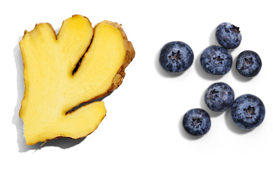 sliced ginger and blueberries