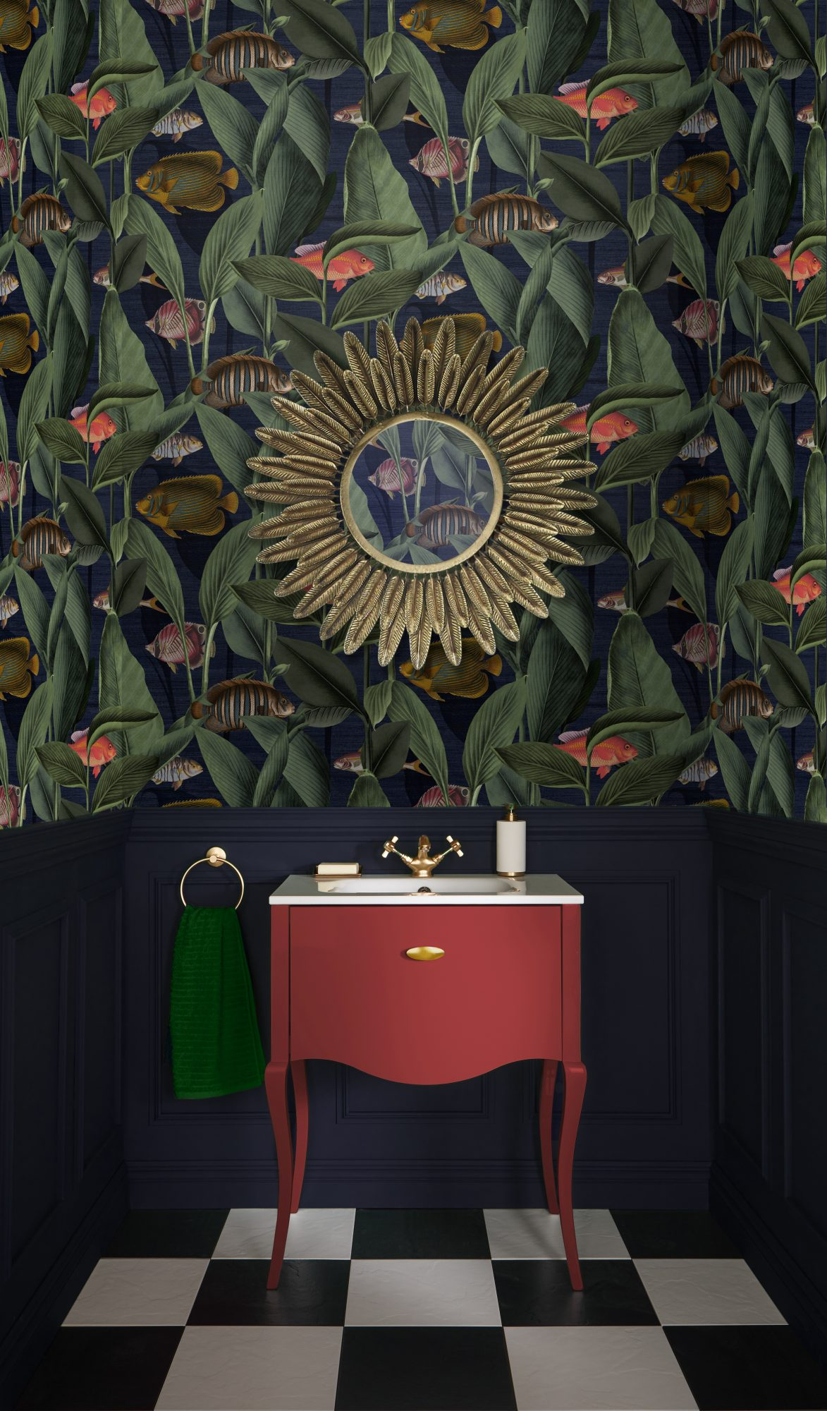 Fish and tropical plant wallpaper behind a red sink and a starburst mirror