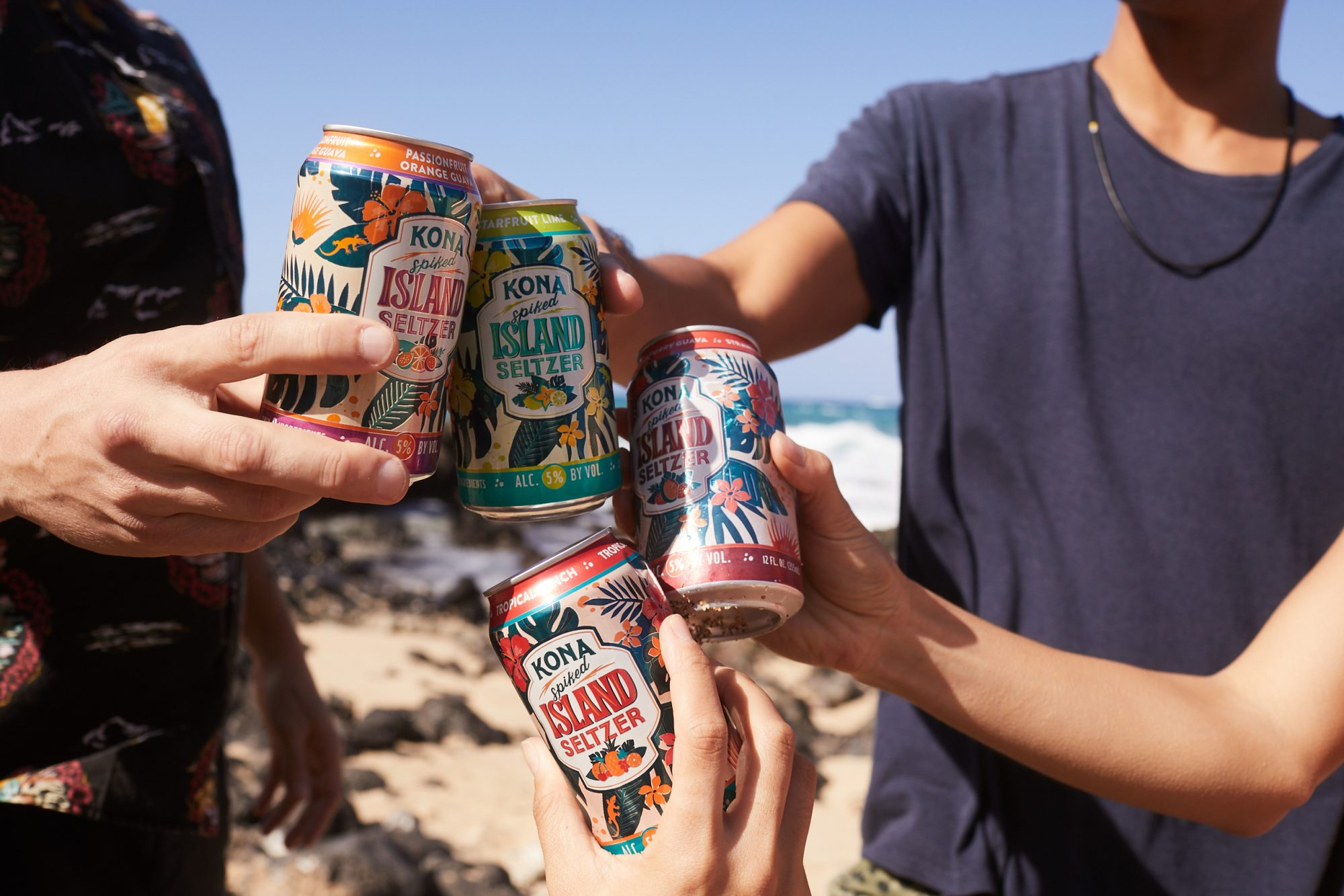 Four people toasting with different cans of Kona Spiked Island Seltzer