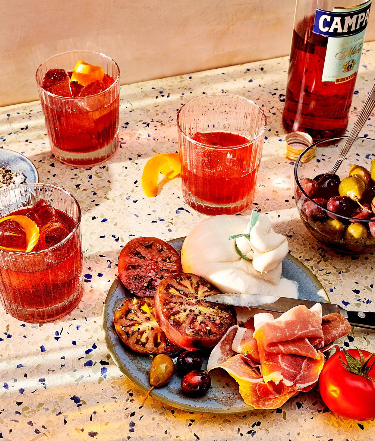 aperitivo drinks tomatoes prosciutto olives terrazzo countertop knife plate