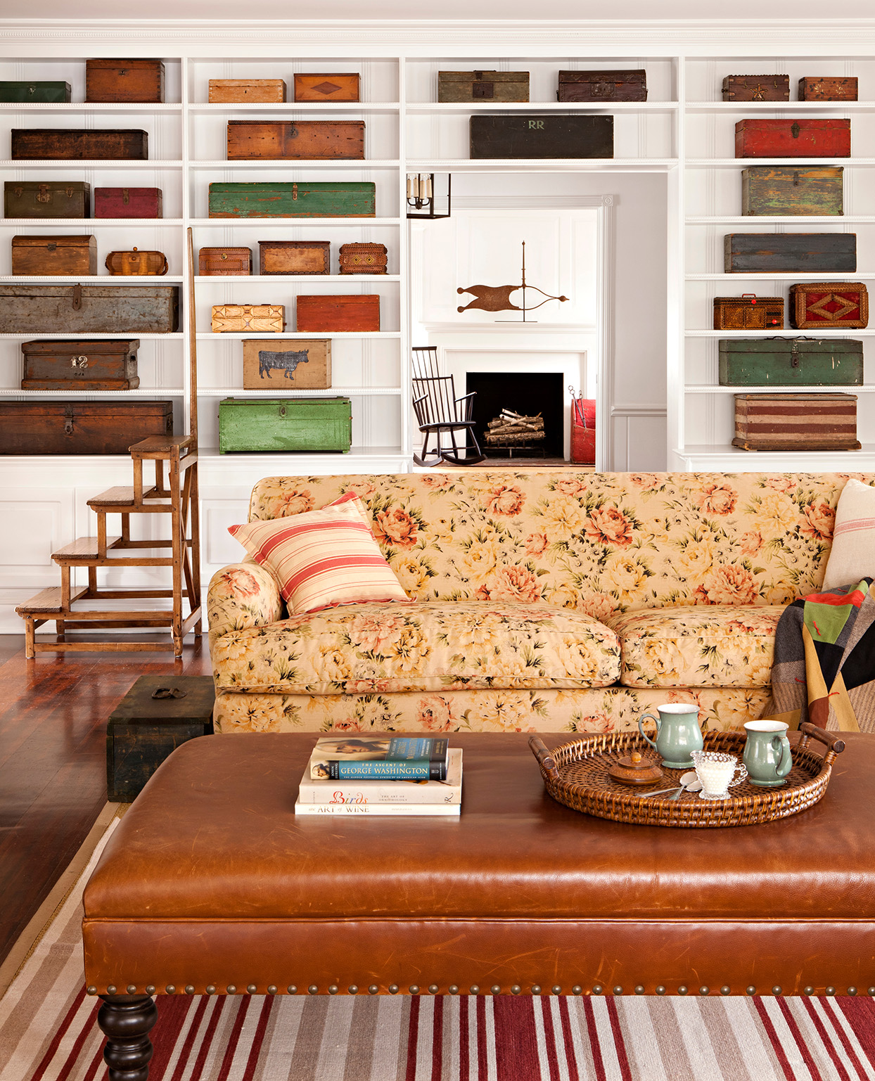 living room with white built-in shelving and patterned sofa