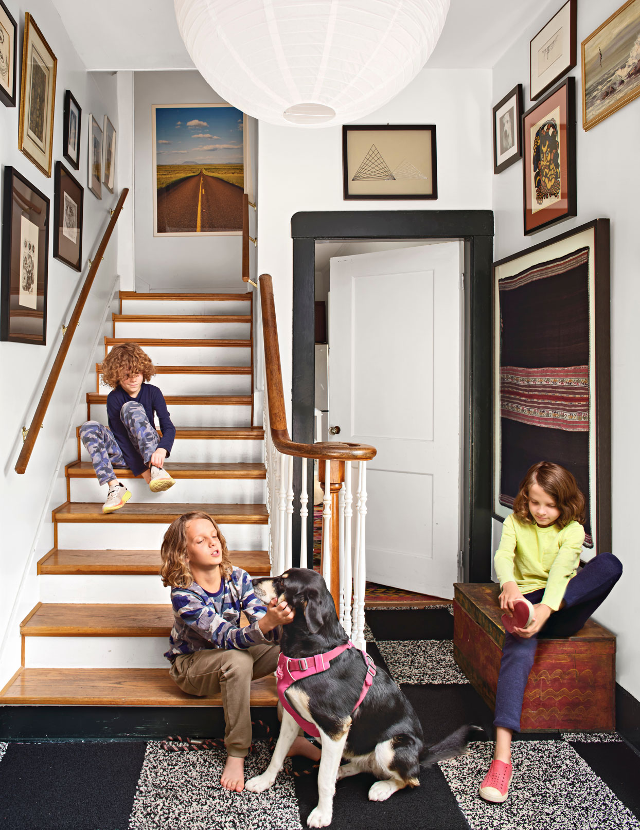 MacPhail boys and dog in entryway