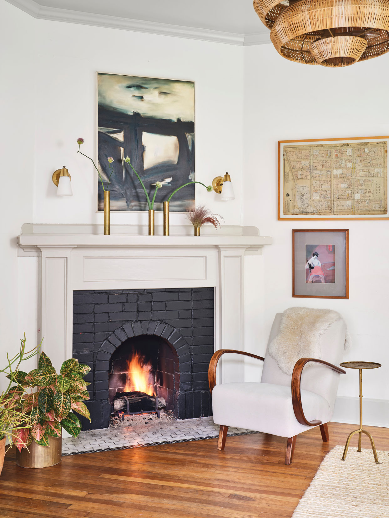 fireplace with gray mantle and black brick