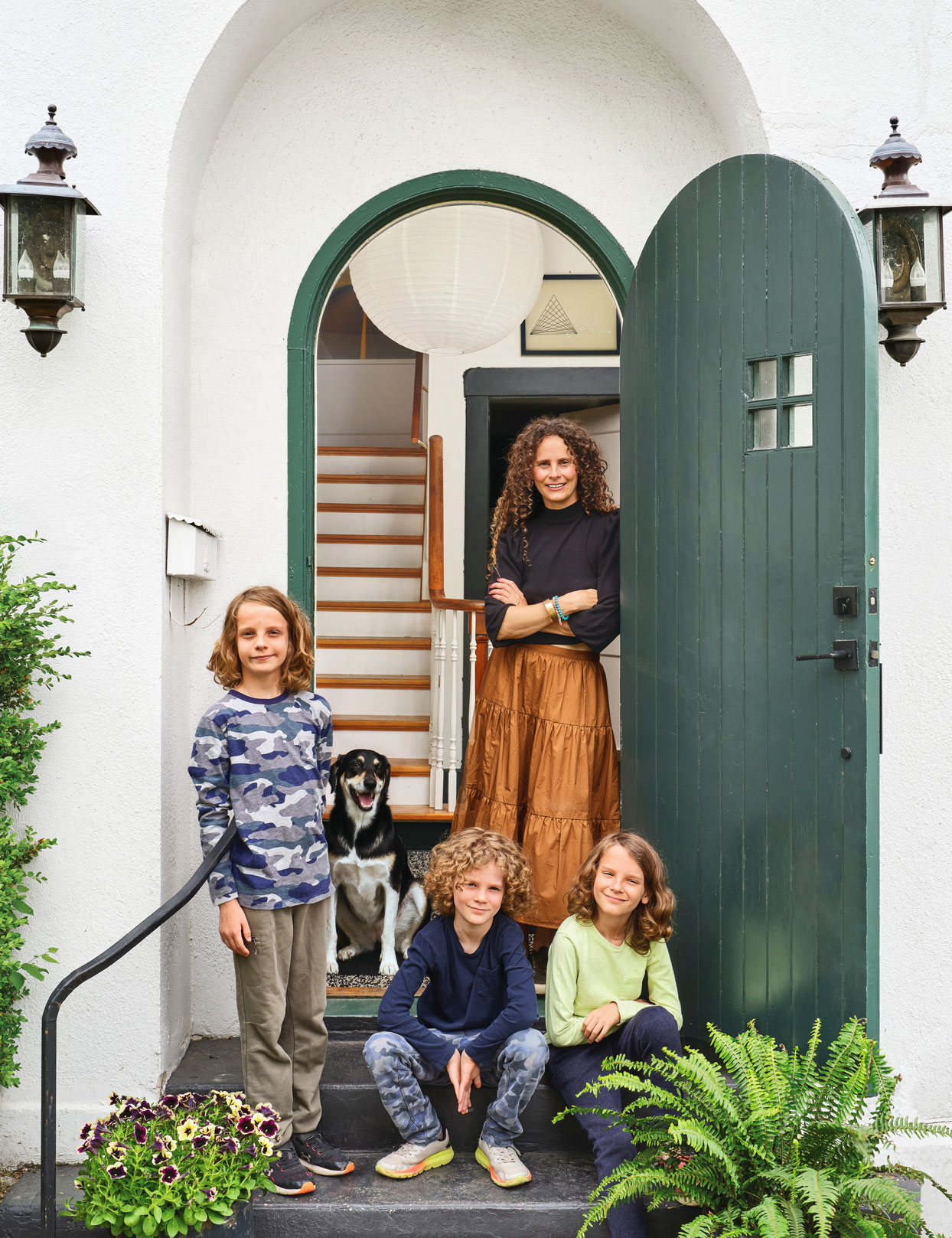 Liz MacPhail in front doorway with her three sons