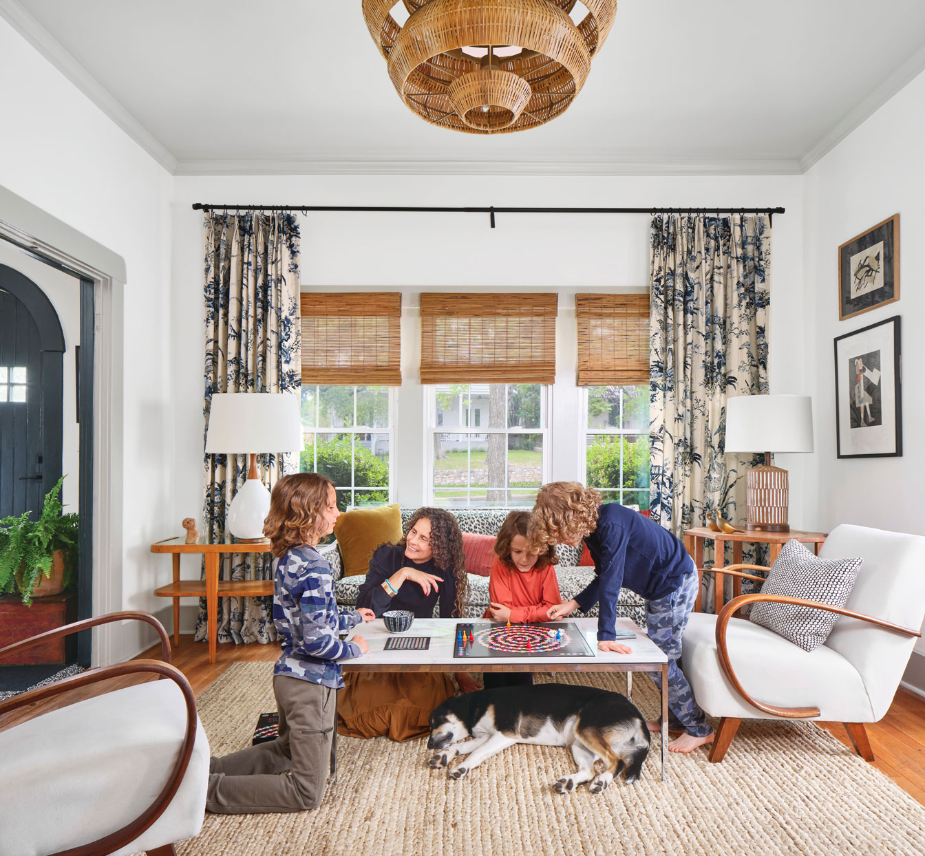 Liz MacPhail playing game with her sons in living room